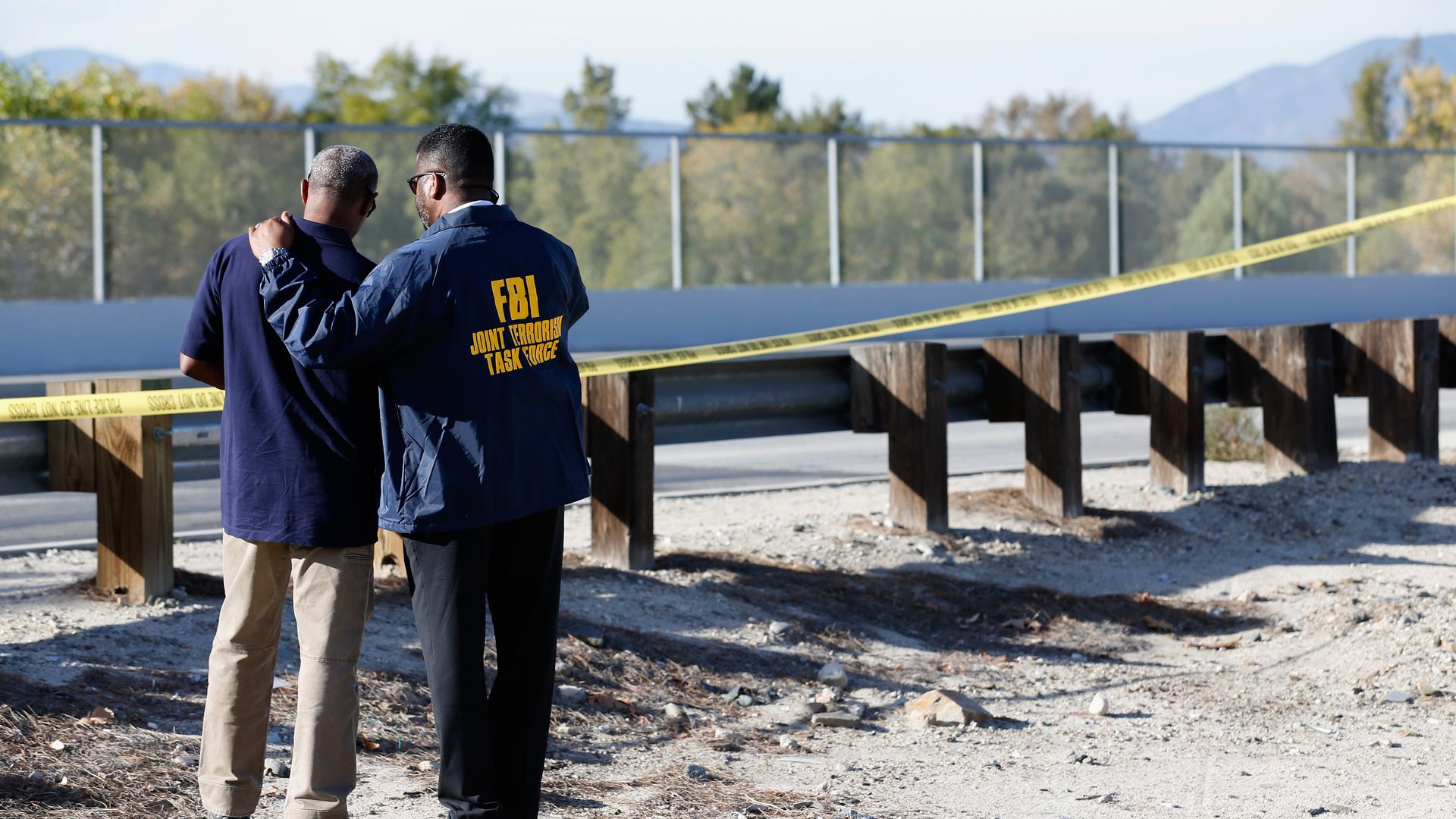 Members of the FBI Joint Terrorism Task Force stand outside of a press conference regarding the shooting that occurred at the Inland Regional Center