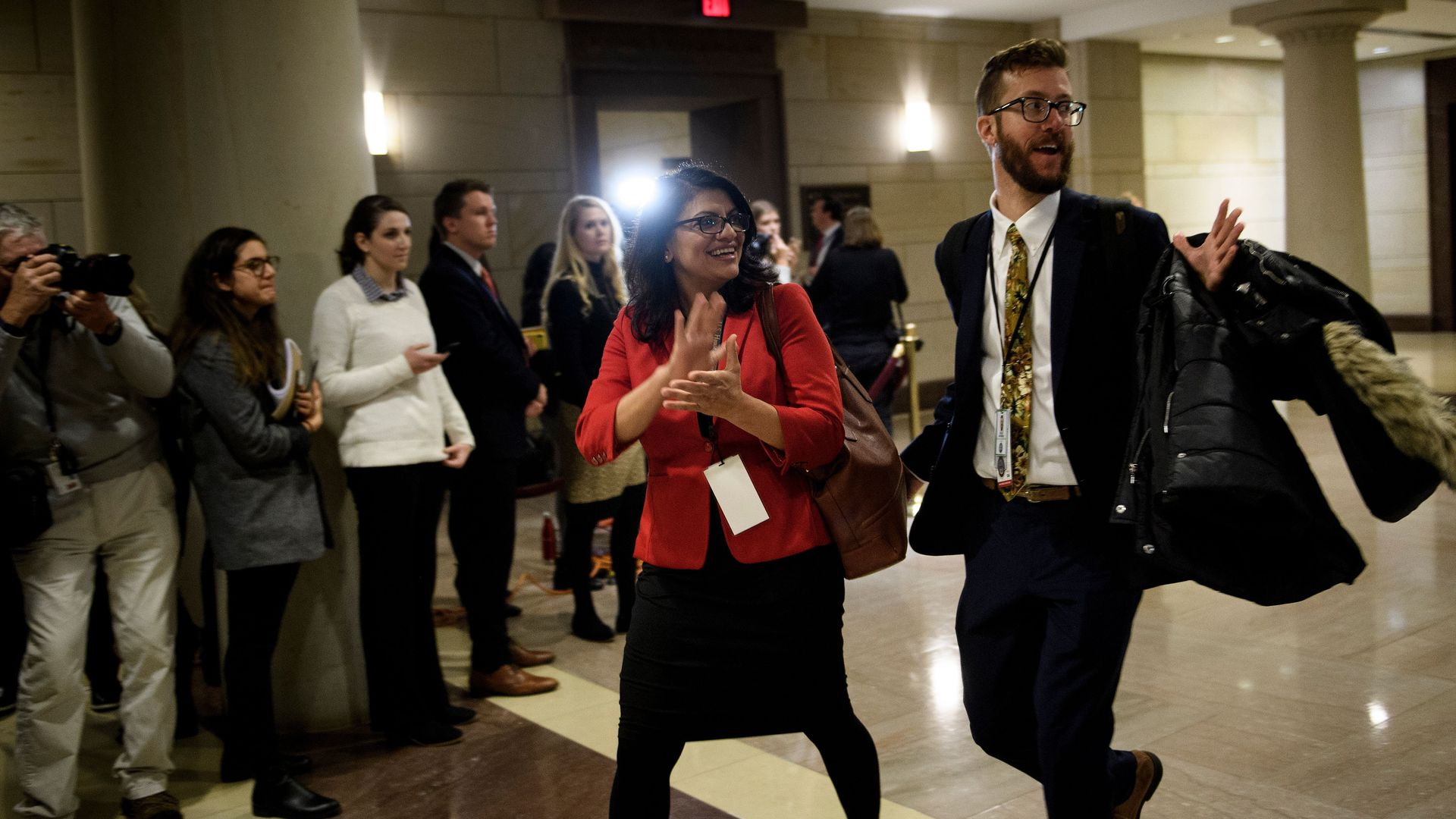 Rashida Tlaib walks through the halls in Congress