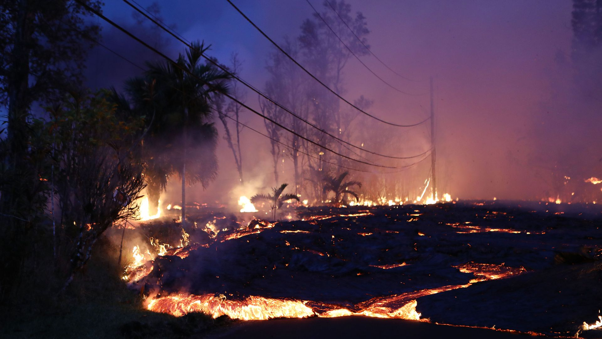 Lava from a Kilauea volcano fissure advances up a residential street in Leilani Estates, on Hawaii's Big Island last month in Pahoa, Hawaii.