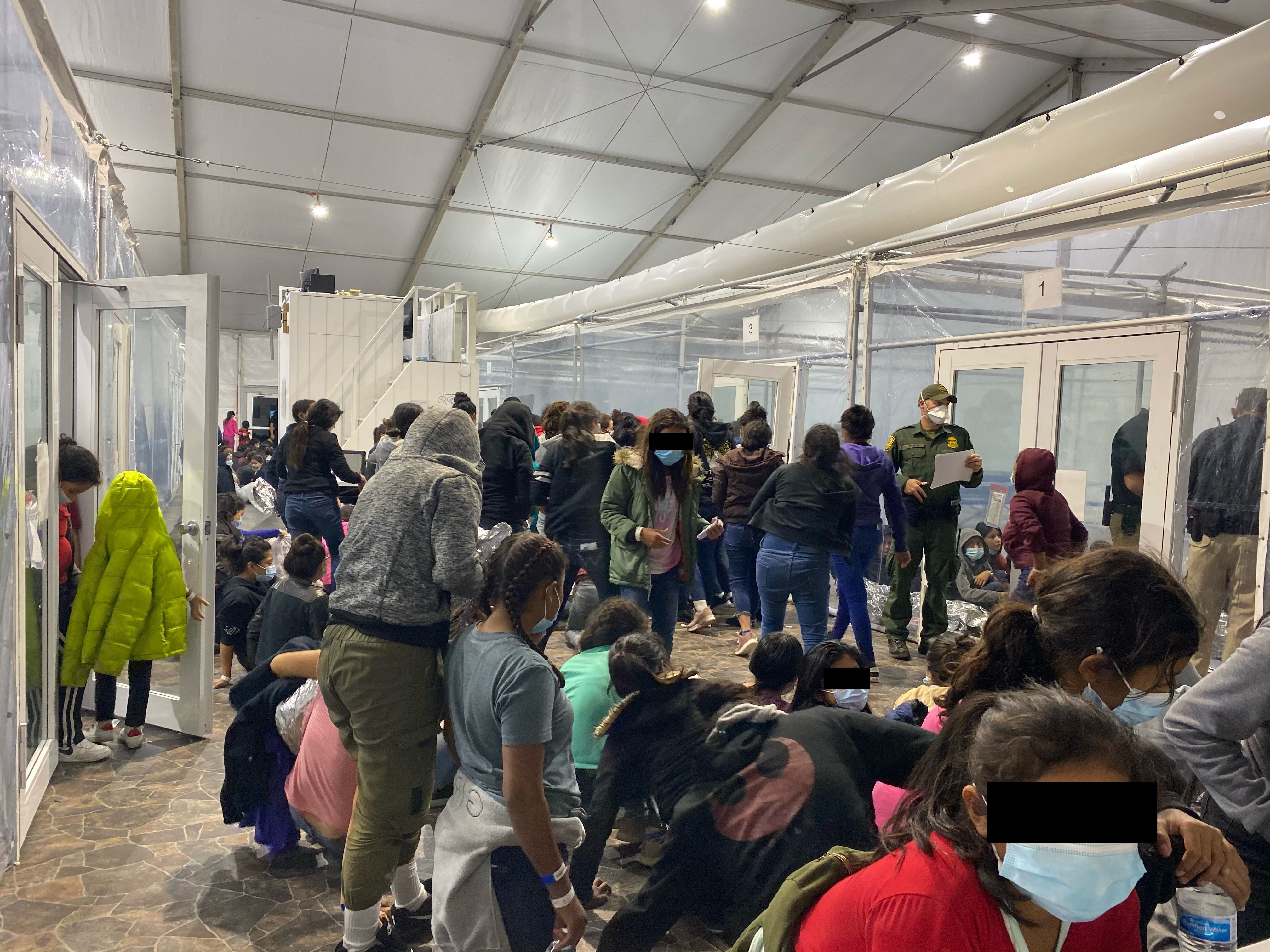 Migrants crowded in border facility in Donna, Texas