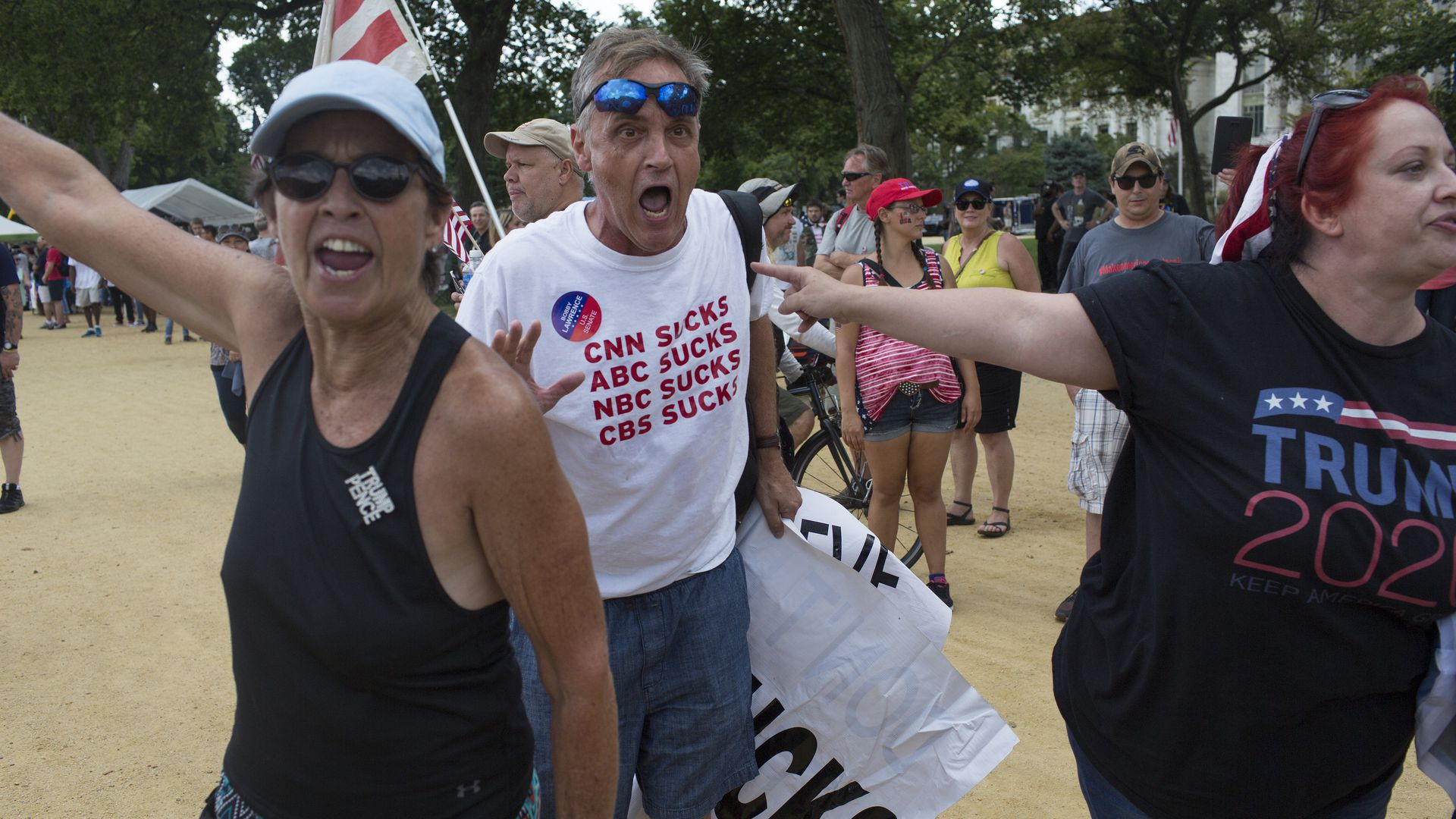 Supporters of U.S. President Donald Trump scream at the media as they gather for what was billed as 'The Mother of all Rallies' on September 16, 2017
