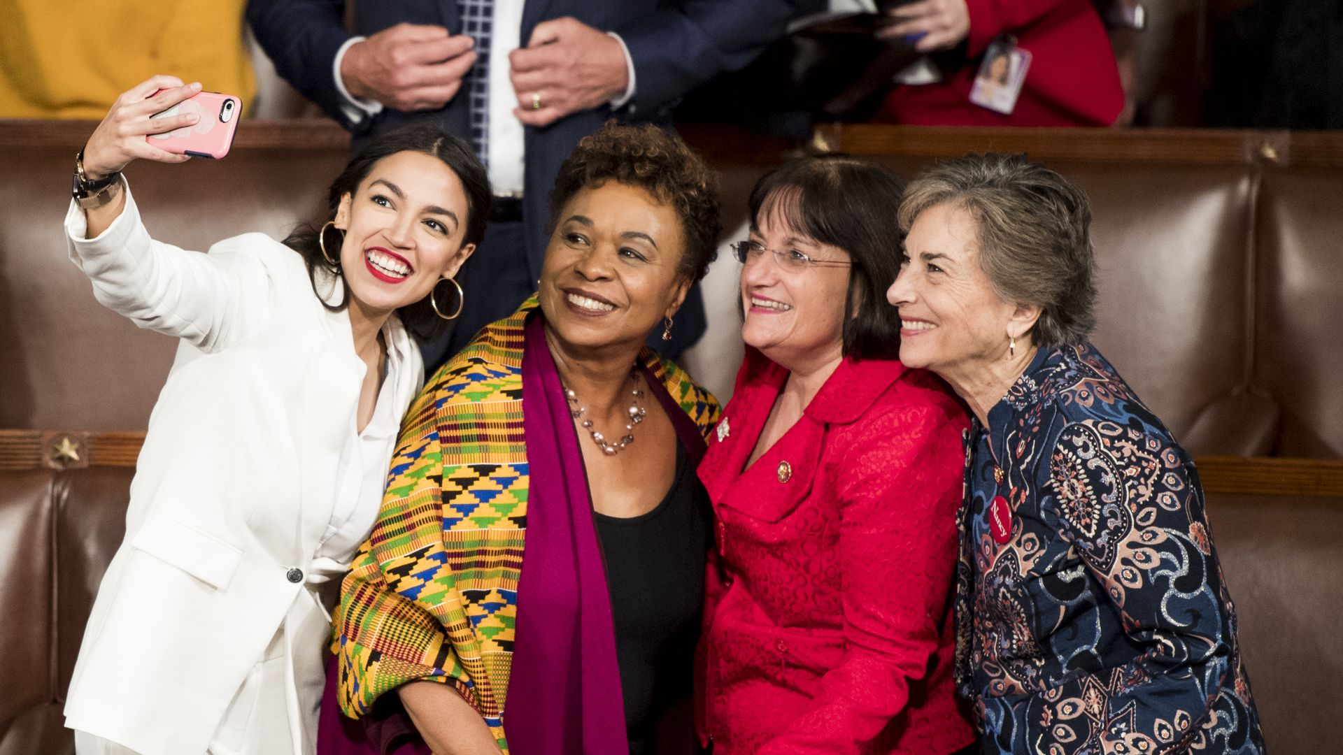 Freshman Reps. from left, Alexandria Ocasio-Cortez, D-N.Y., Barbara Lee, D-Texas, Annie Kuster, D-N.H., and Jan Schakowsky, D-Ill., take a selfie on the House floor before the start of the election