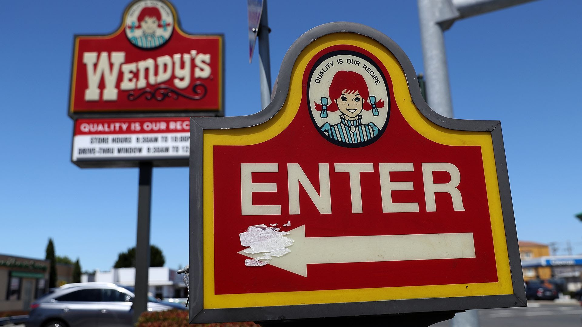 "Photo of a Wendy's sign that says ""ENTER"" with an arrow"