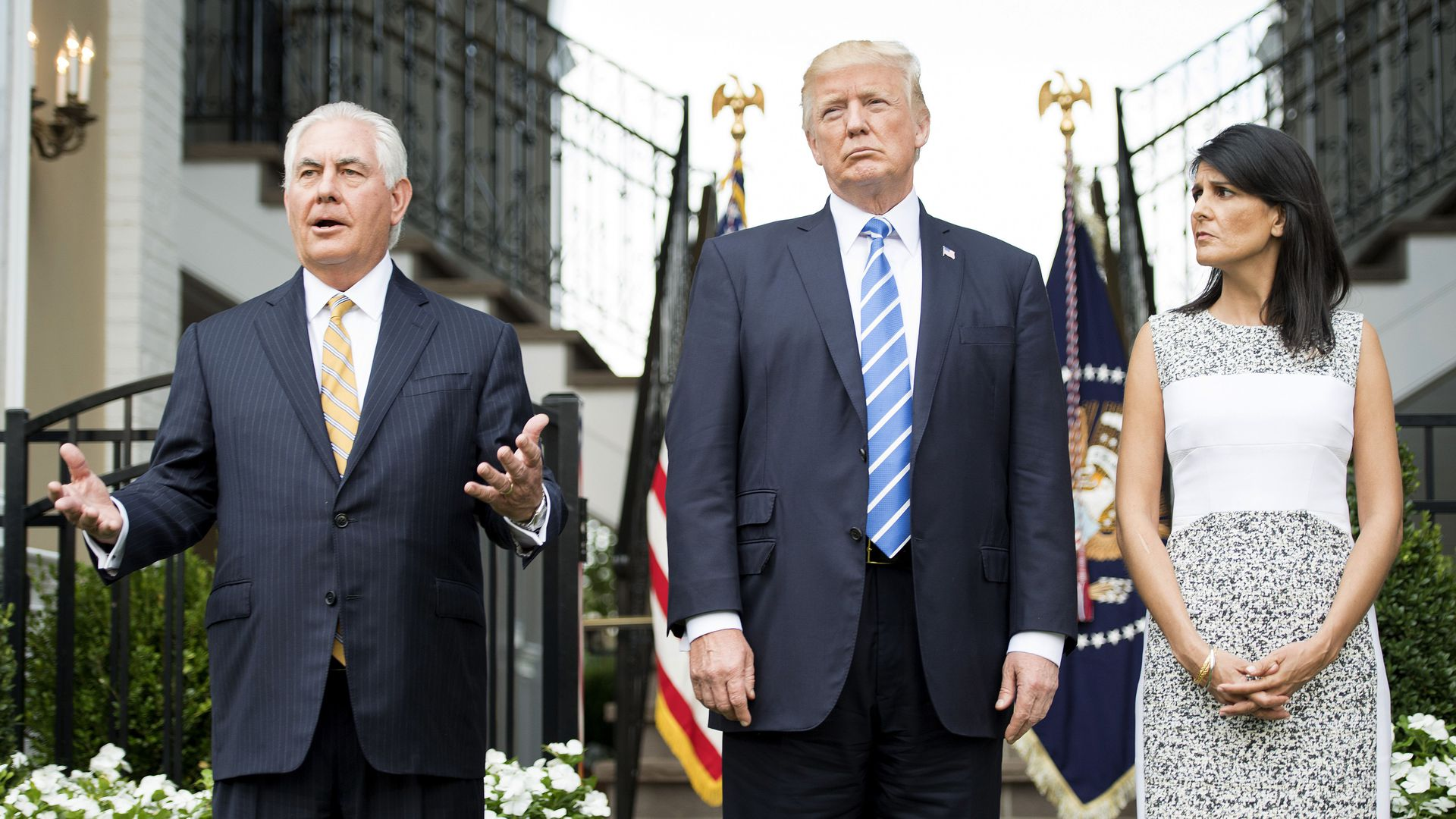 Secretary of State Rex Tillerson (L) speaks to the press with US President Donald Trump (C) and US Ambassador to the United Nations Nikki Haley (R) on August 11, 2017
