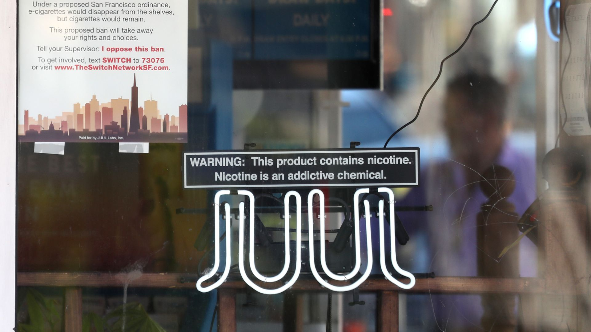 A neon sign advertising Juul e-cigarettes.