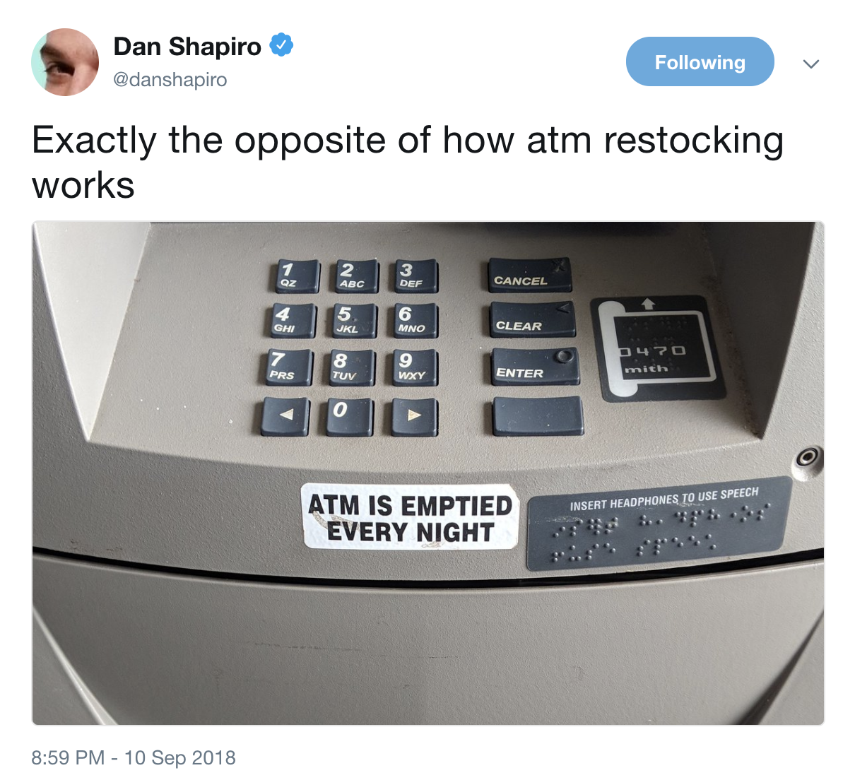 Tweet of an ATM with a sticker saying that it is emptied each night.