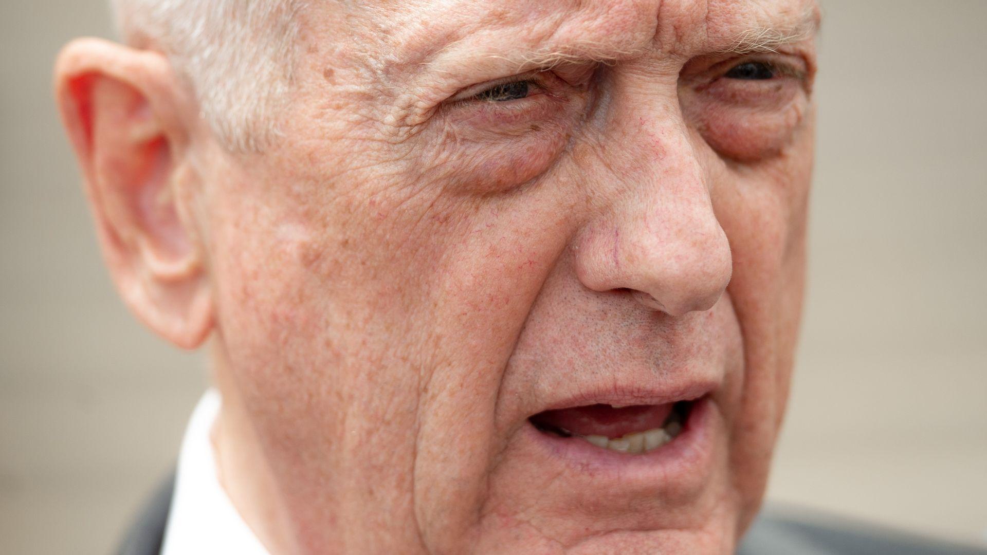 Closeup of Sec Def's Mattis face, he looks surprised.