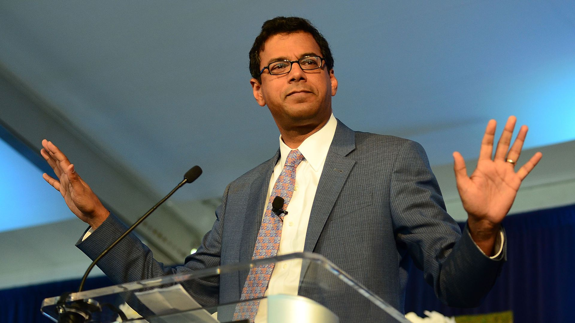 Atul Gawande speaks at a podium.