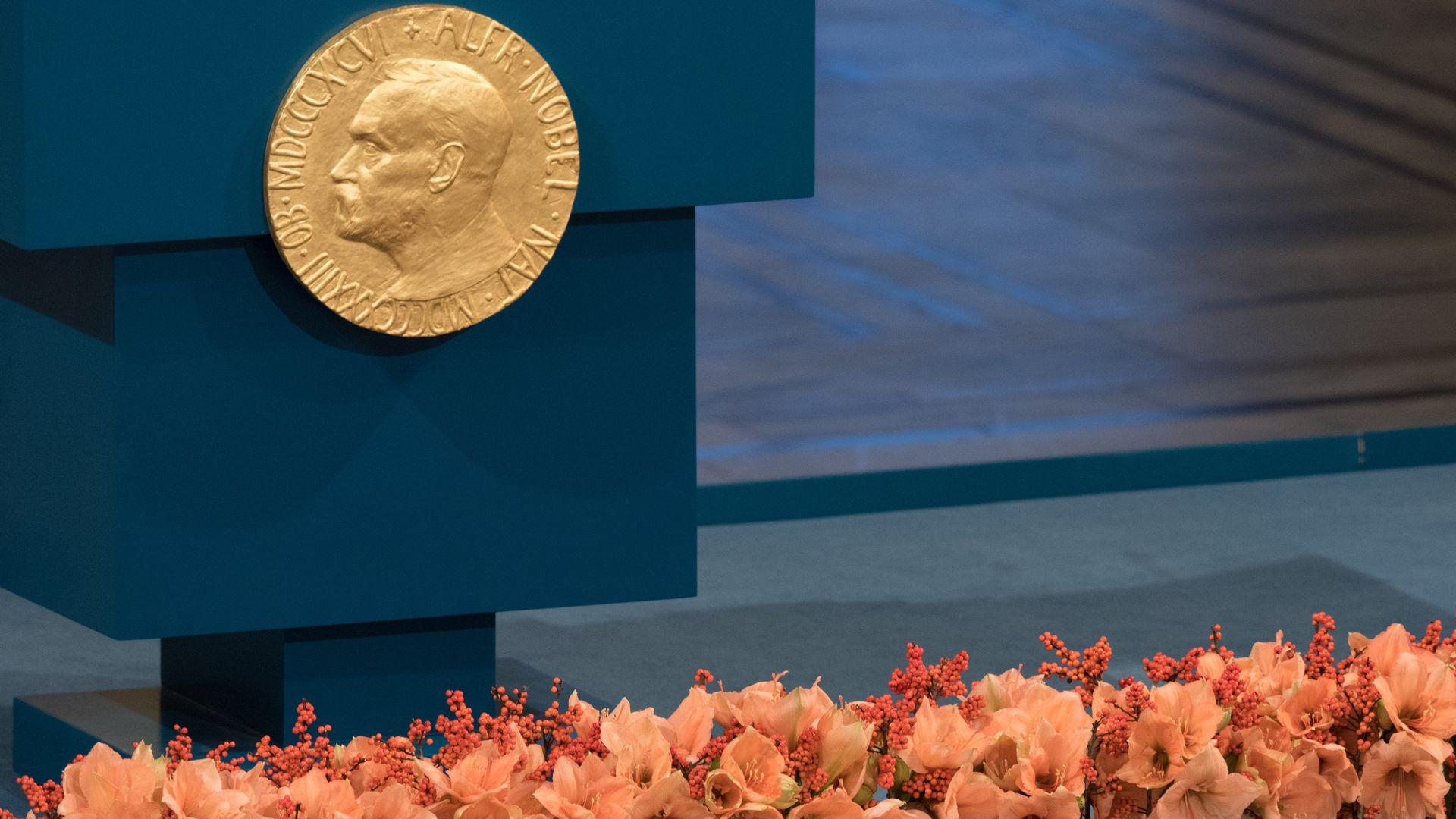 A plaque depicting Alfred Nobel adorns the lecturn prior to 2015 ceremony in Oslo, Norway.