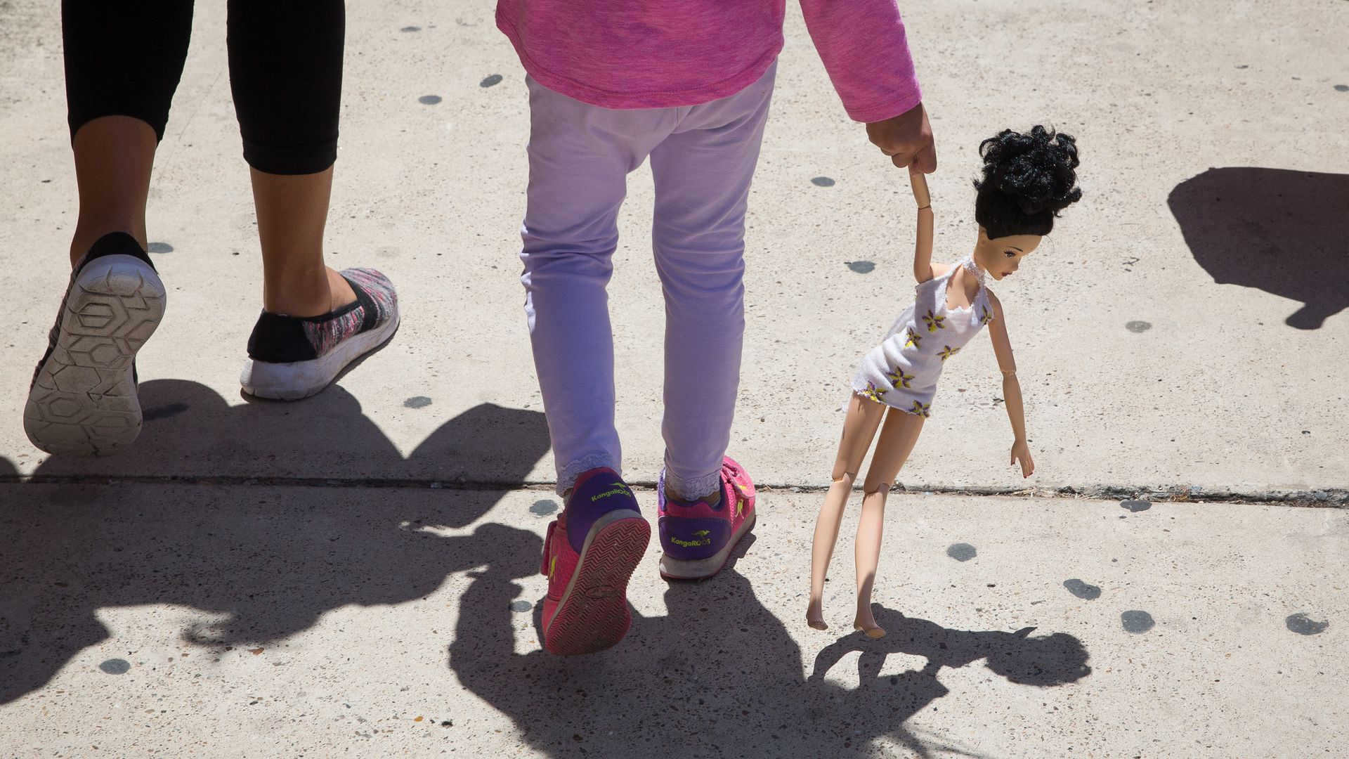 An immigrant mother walking with her child