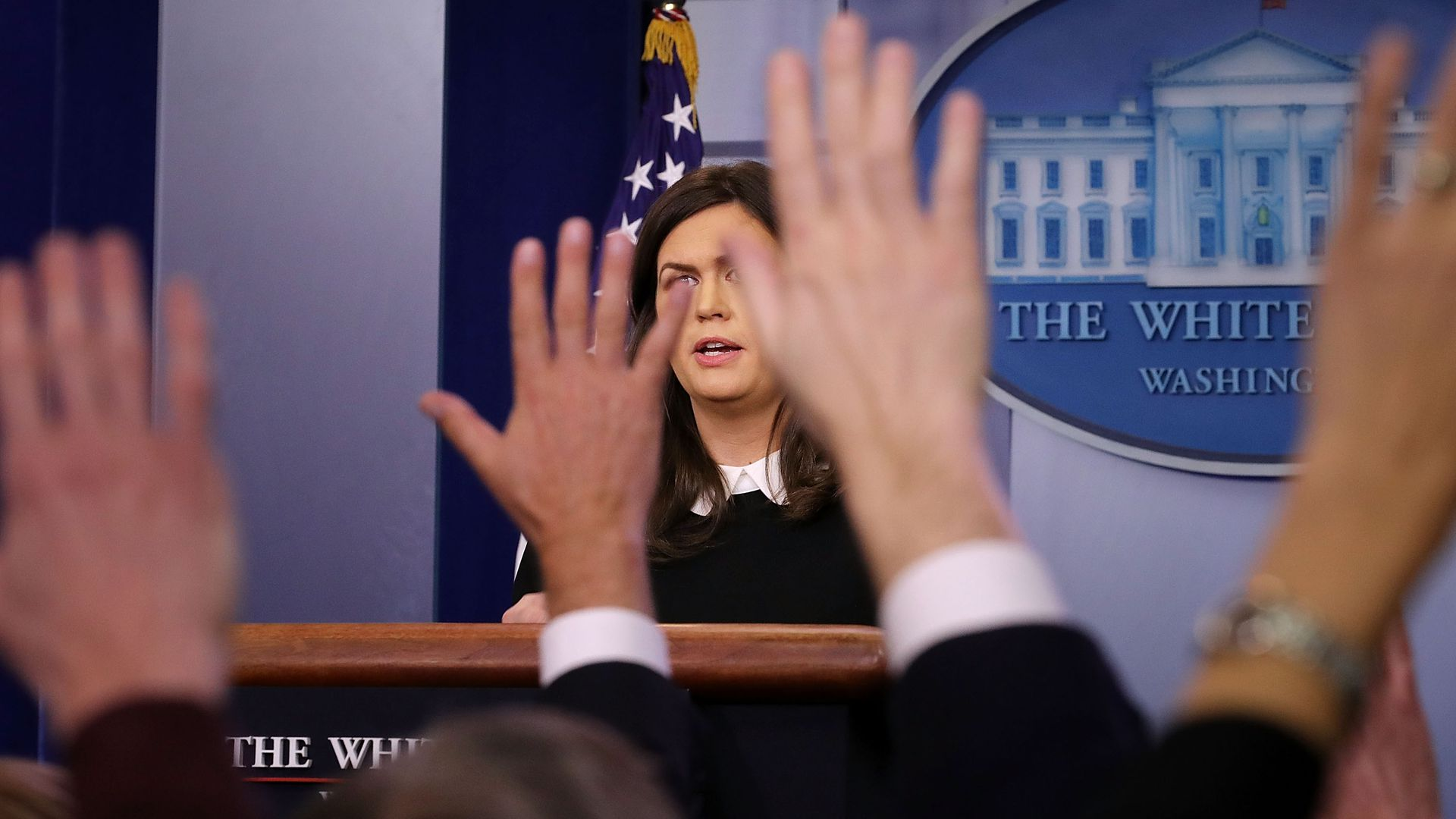 Sarah Sanders takes questions during the White House press briefing.