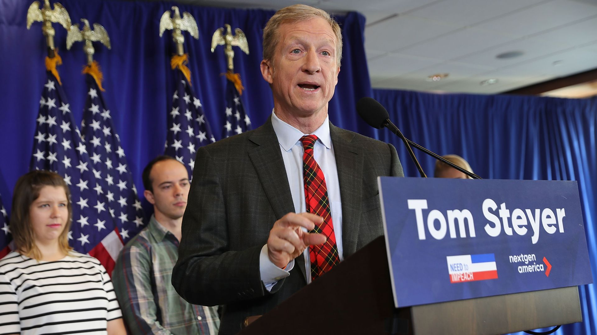 Tom Steyer standing at a podium.