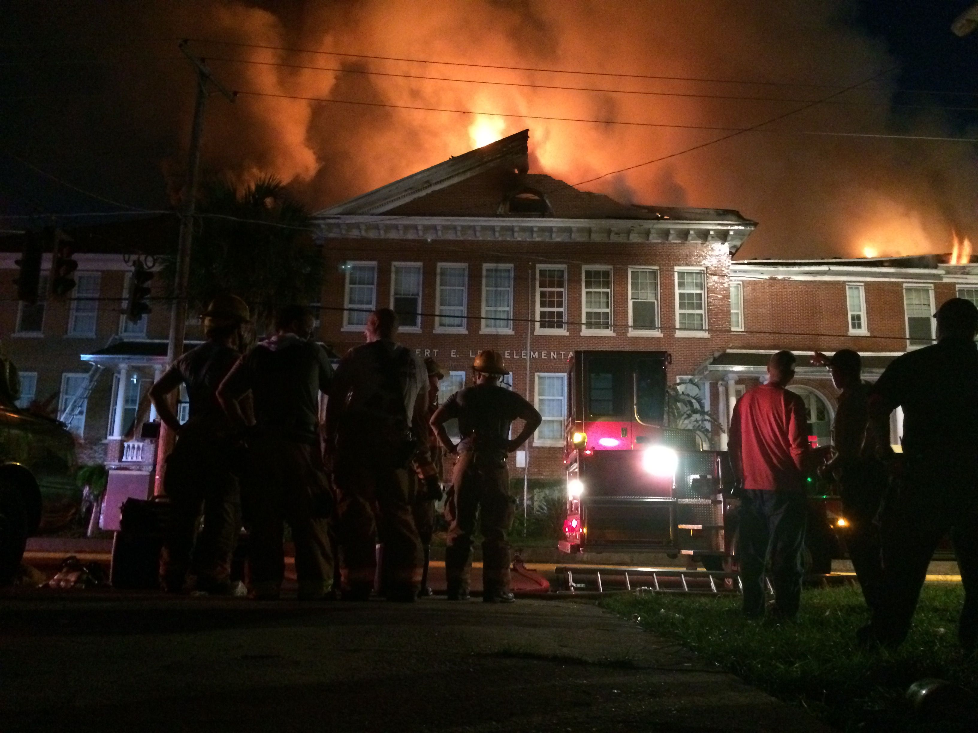 A photo of flames coming out the top of the Robert E. Lee Elementary in Tampa, Florida.