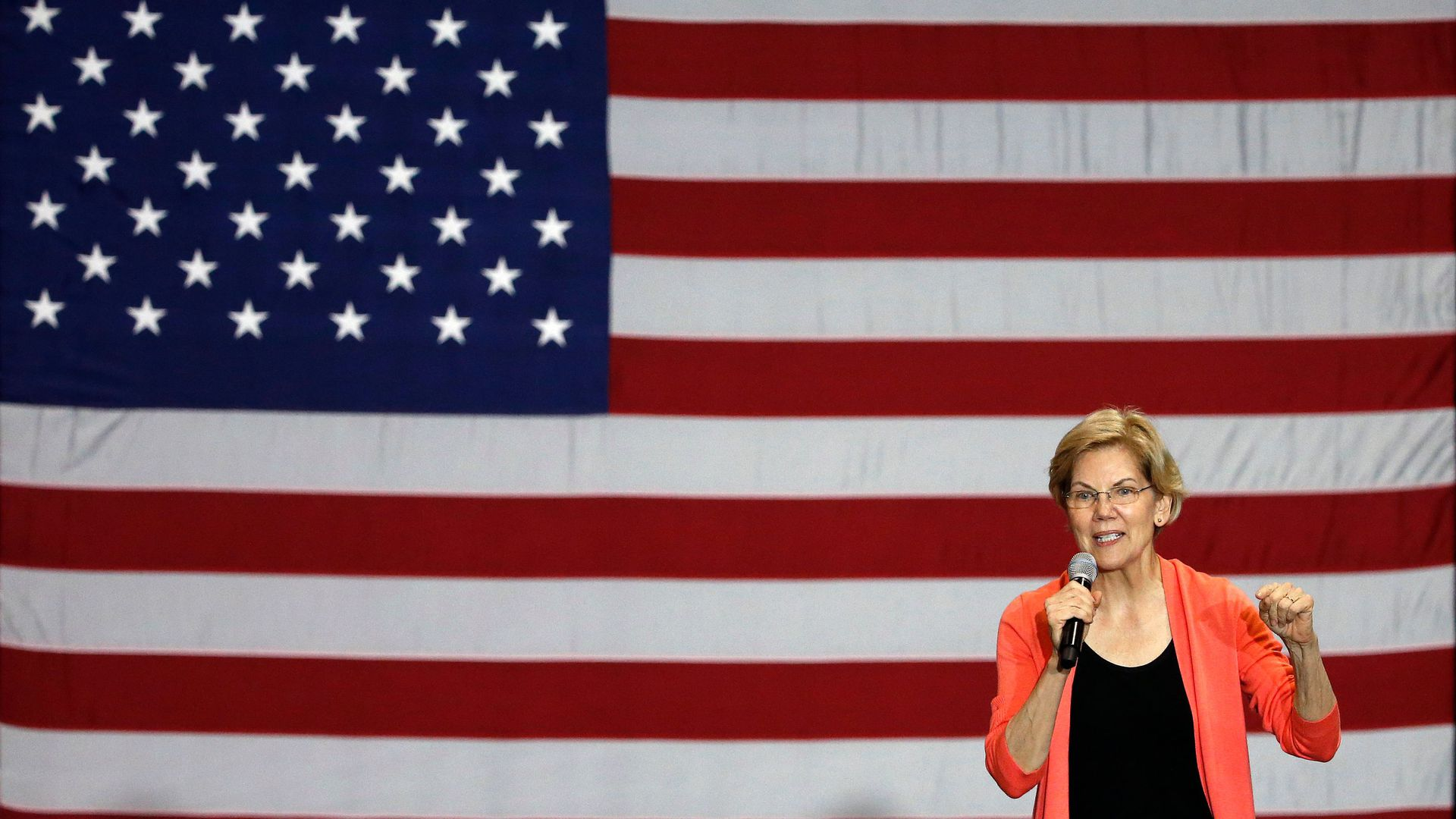 Senator of Massachusetts (D) and Democratic Presidential hopeful Elizabeth Warren gestures as she speaks during a town hall meeting at Florida International University in Miami, Florida on June 25.