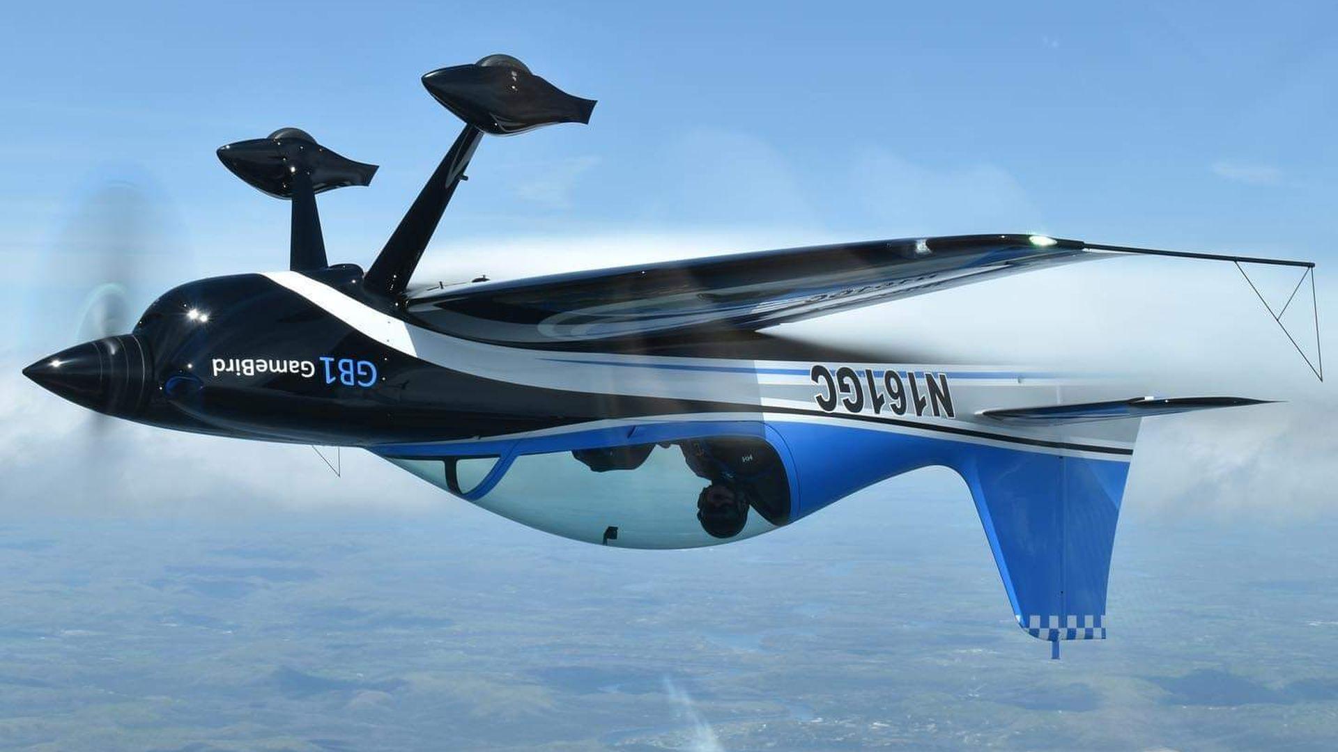 A GameBird 1 stunt plane flies upside down.