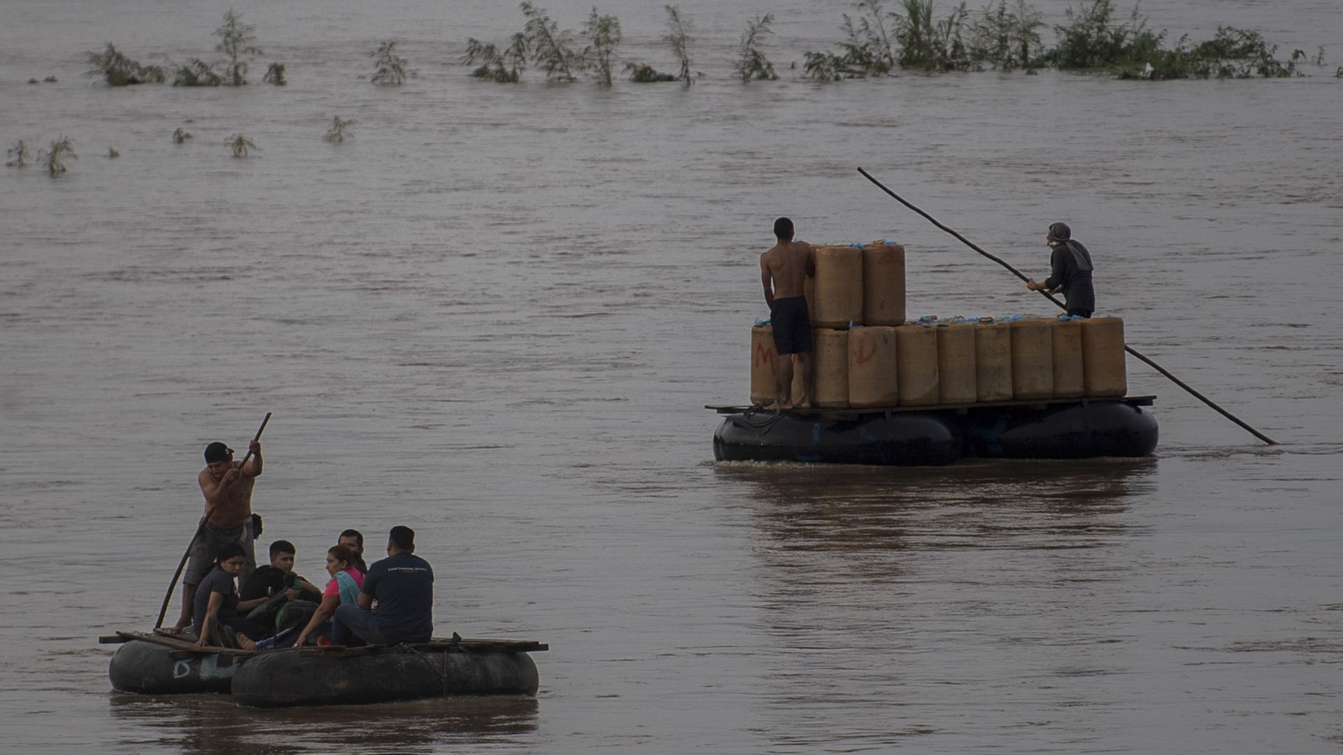 Migrants use rafts to cross the Suchiate river from Ciudad Hidalgo in Chiapas State, Mexico, to Tecun Uman in Guatemala