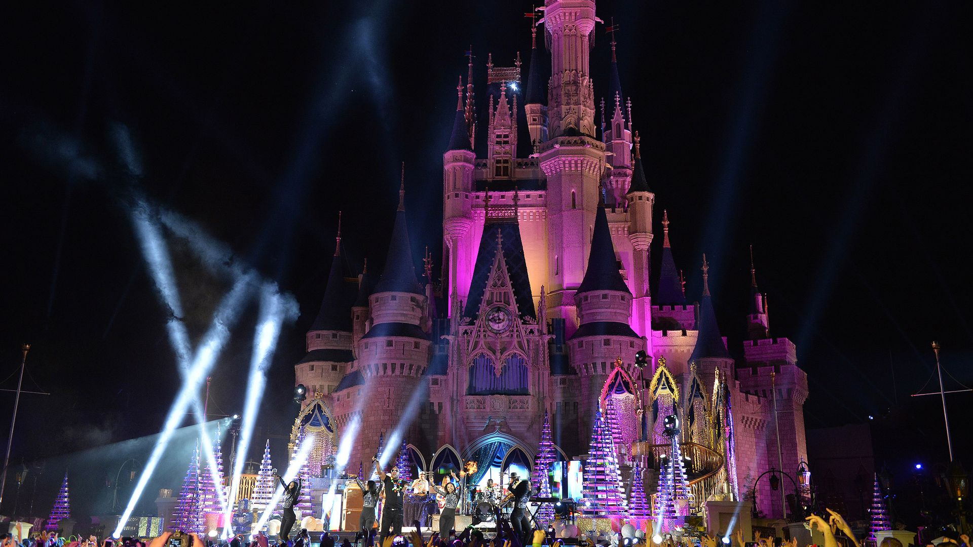 A view of the castle in Disney World at night