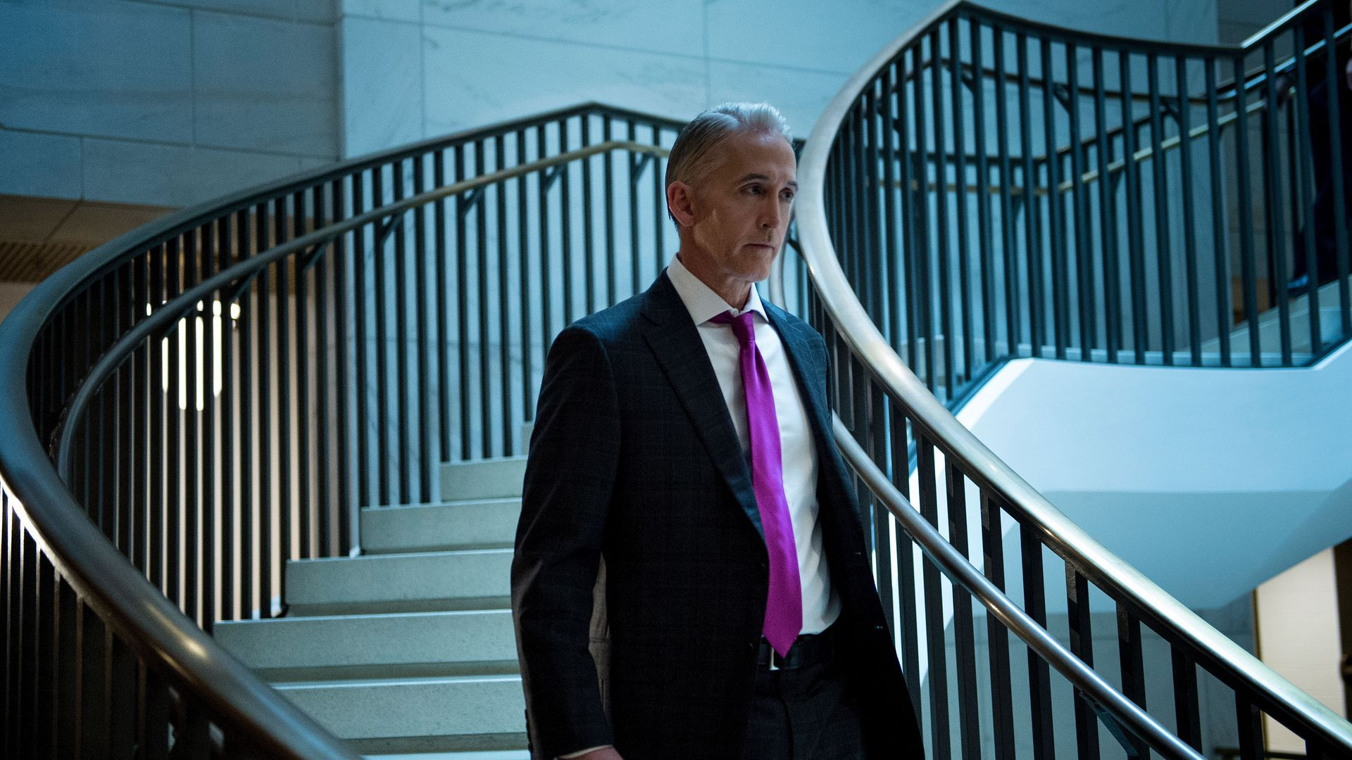 Trey Gowdy walks down a flight of stairs