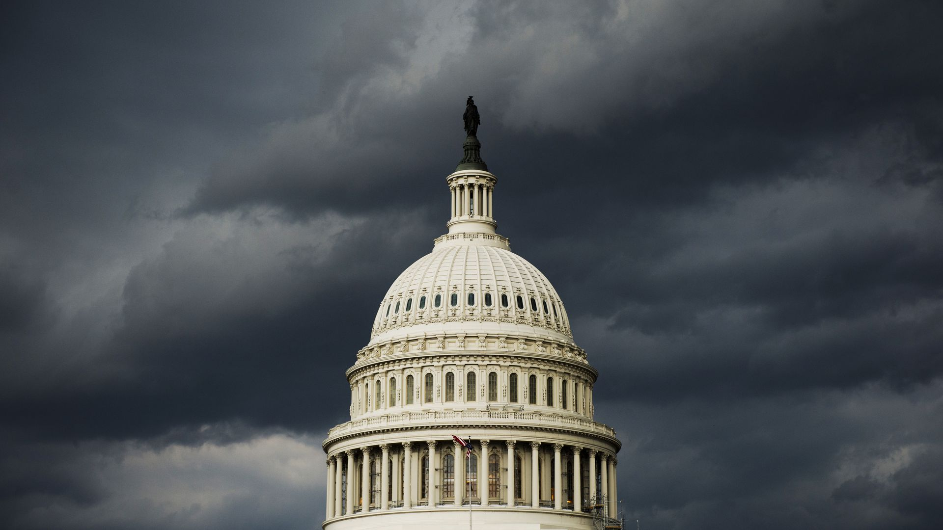 The Capitol Dome under storm clouds