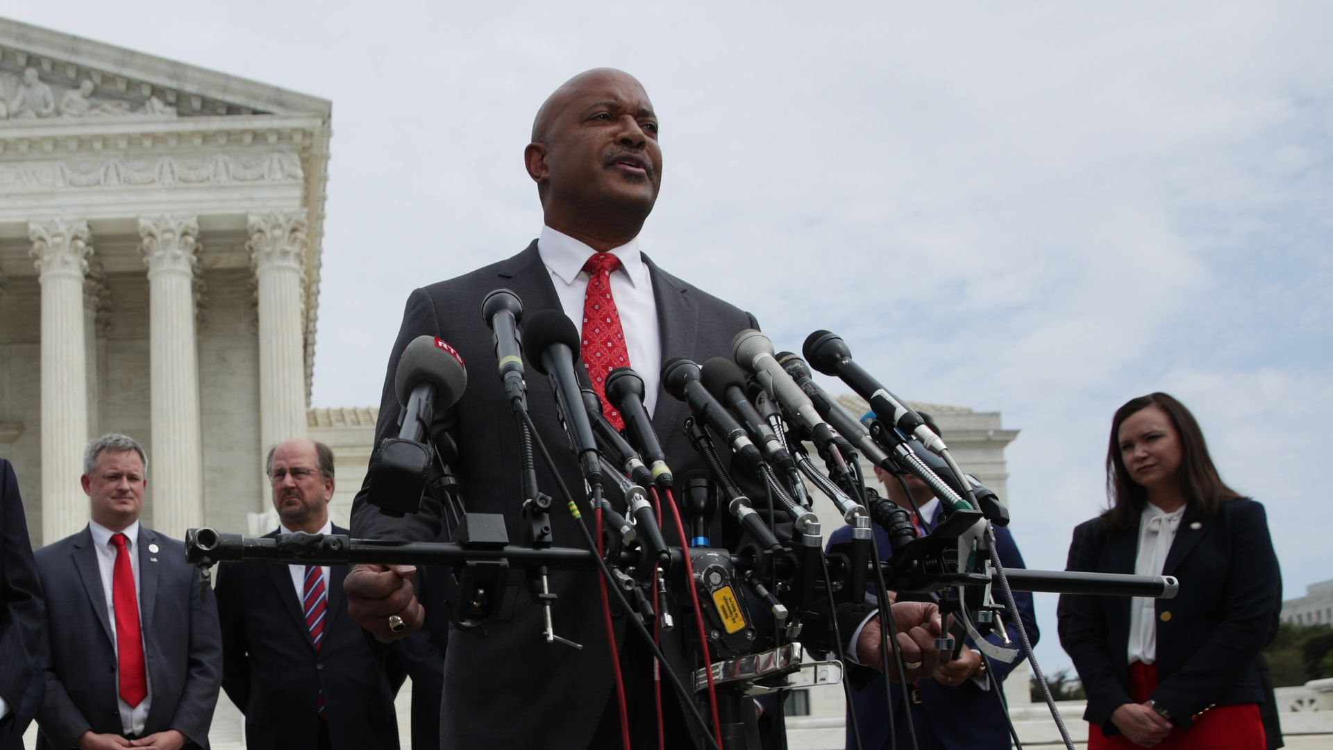 Indiana Attorney General Curtis Hill speaks as Washington, DC Attorney General Karl Racine at a news conference