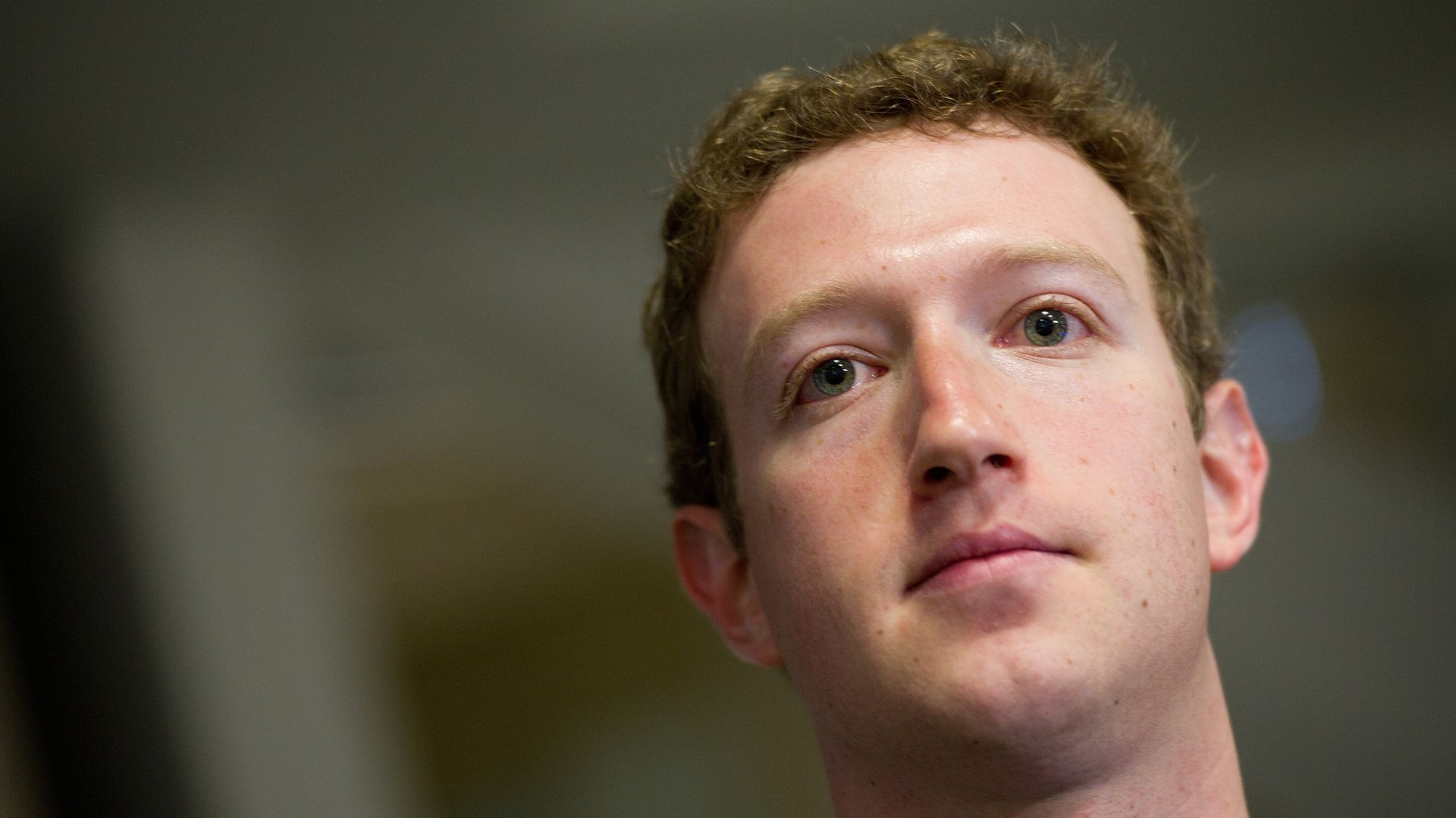 Mark Zuckerberg looks away from the camera