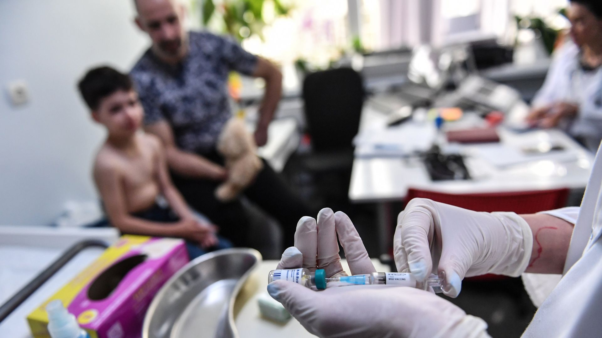 A family physician prepares a measles vaccine during a consultation on April 16, 2018 in the Romanian capital, Bucharest.