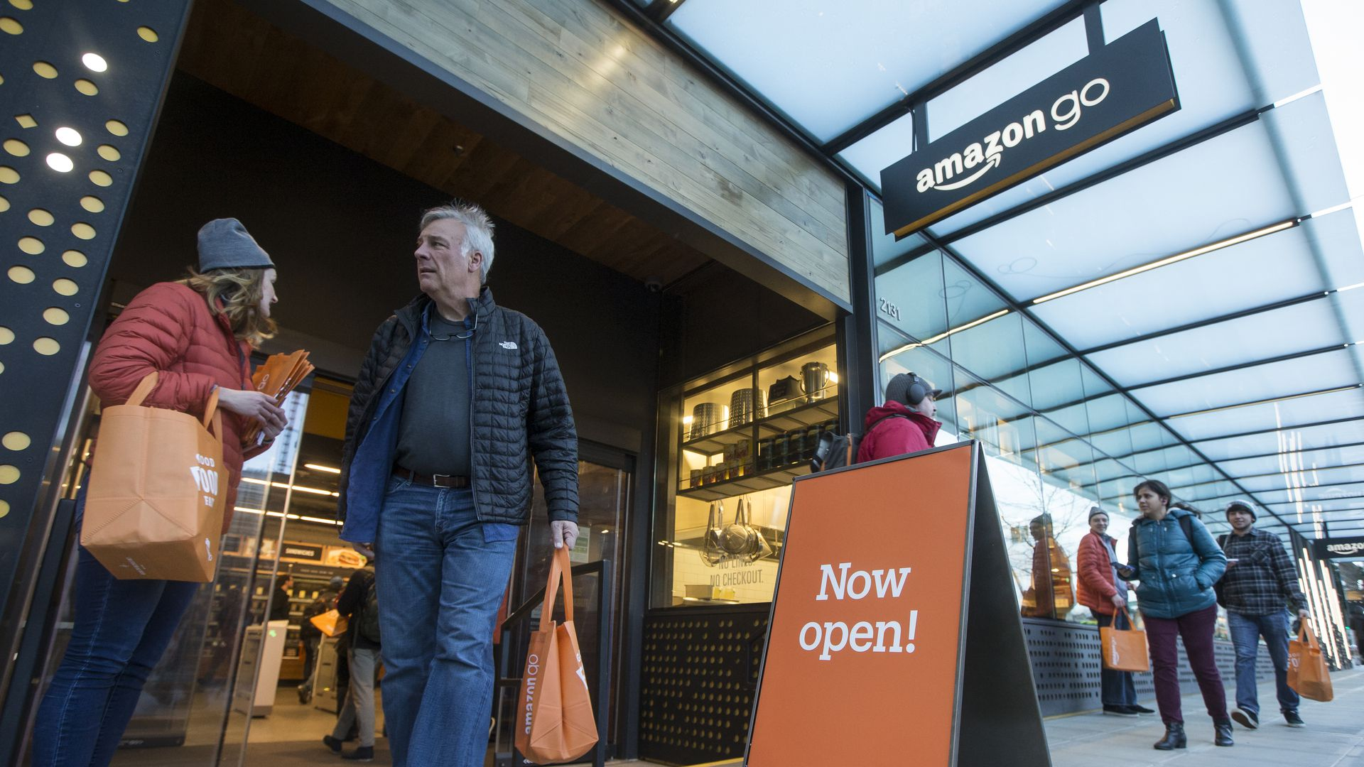 A shopper walks out the the Amazon Go store, on January 22, 2018 in Seattle, Washington. After more than a year in beta Amazon opened the cashier-less store to the public.