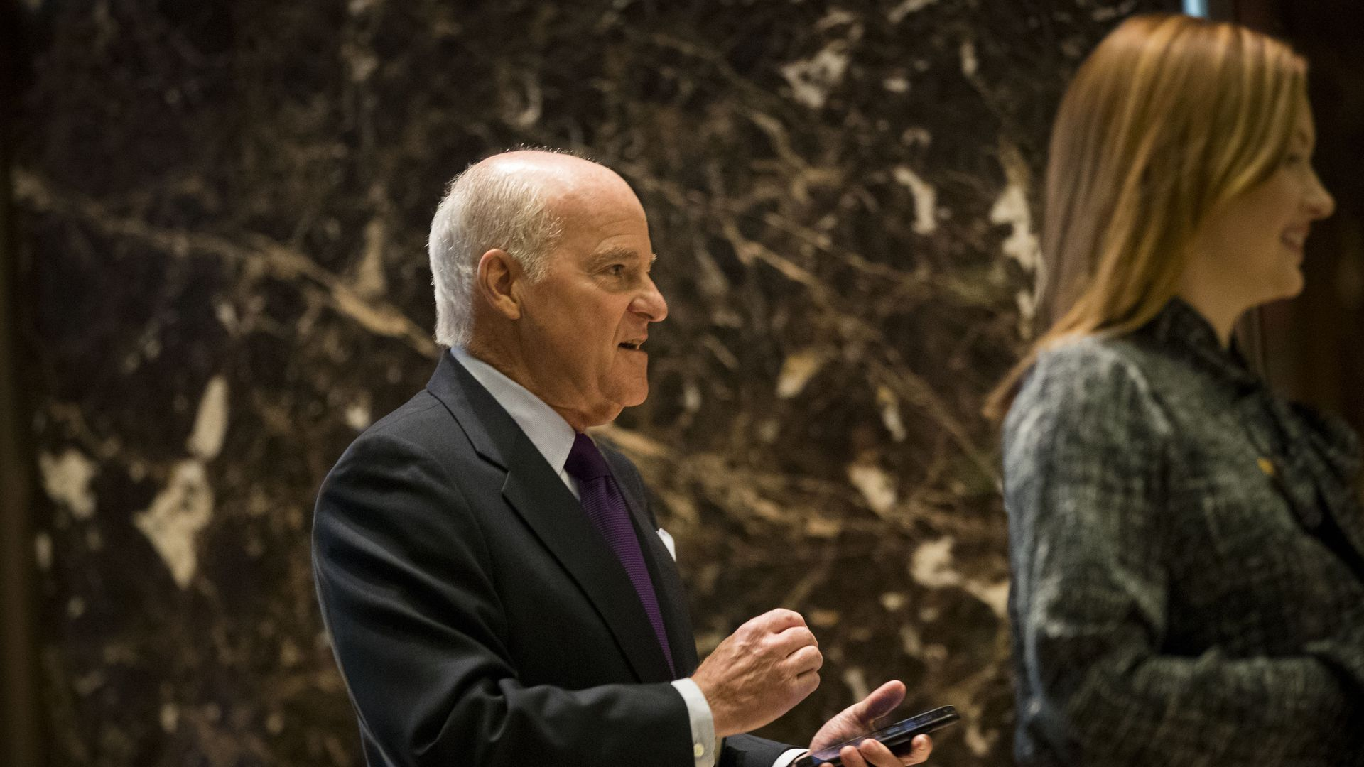KKR co-founder Henry Kravis enters Trump Tower.