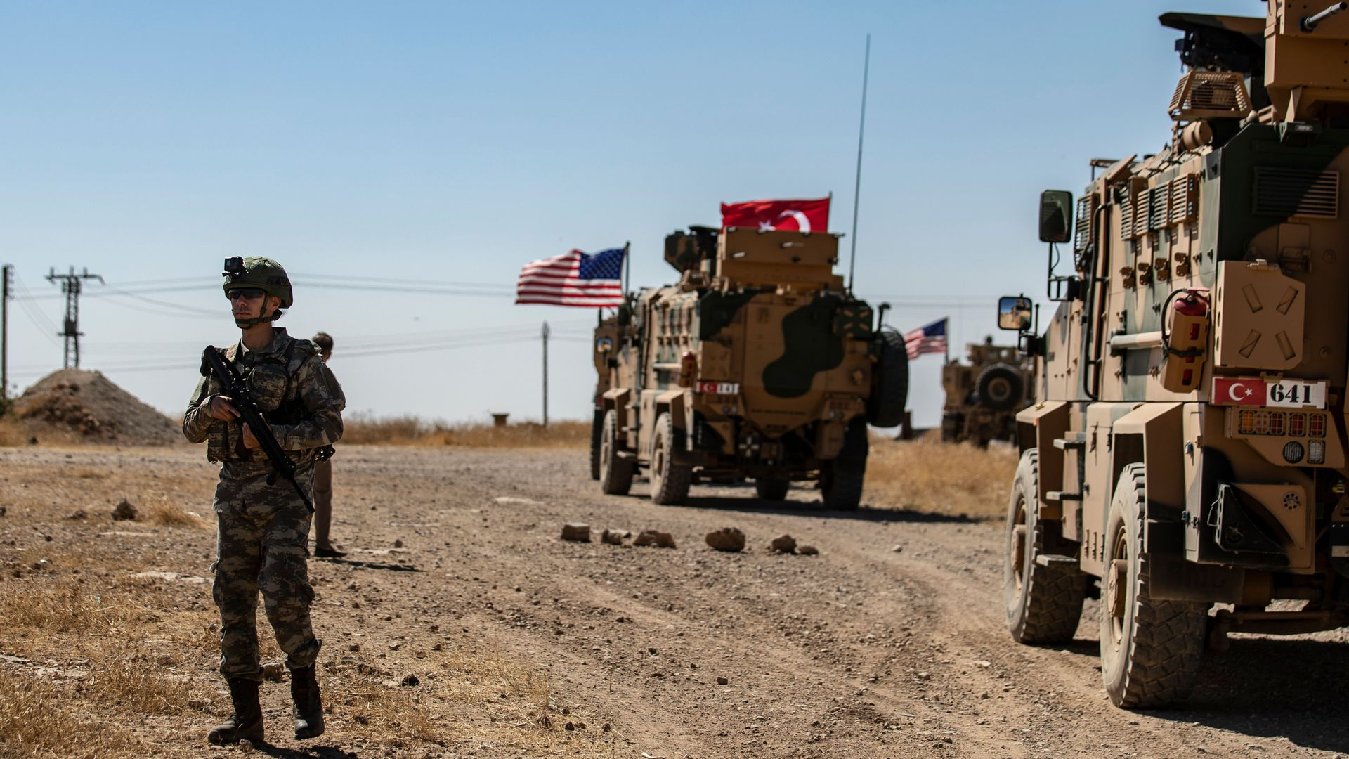 A US soldier stands guard during a joint patrol with Turkish troops in the Syrian village of al-Hashisha on the outskirts of Tal Abyad town along the border with Turkish troops, on September 8, 2019.