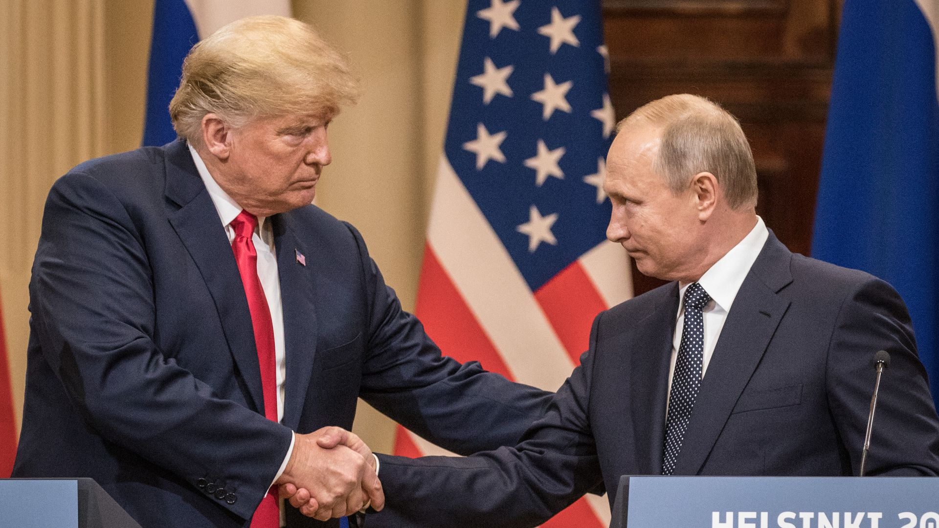 Putin shaking hands with Trump in Helsinki