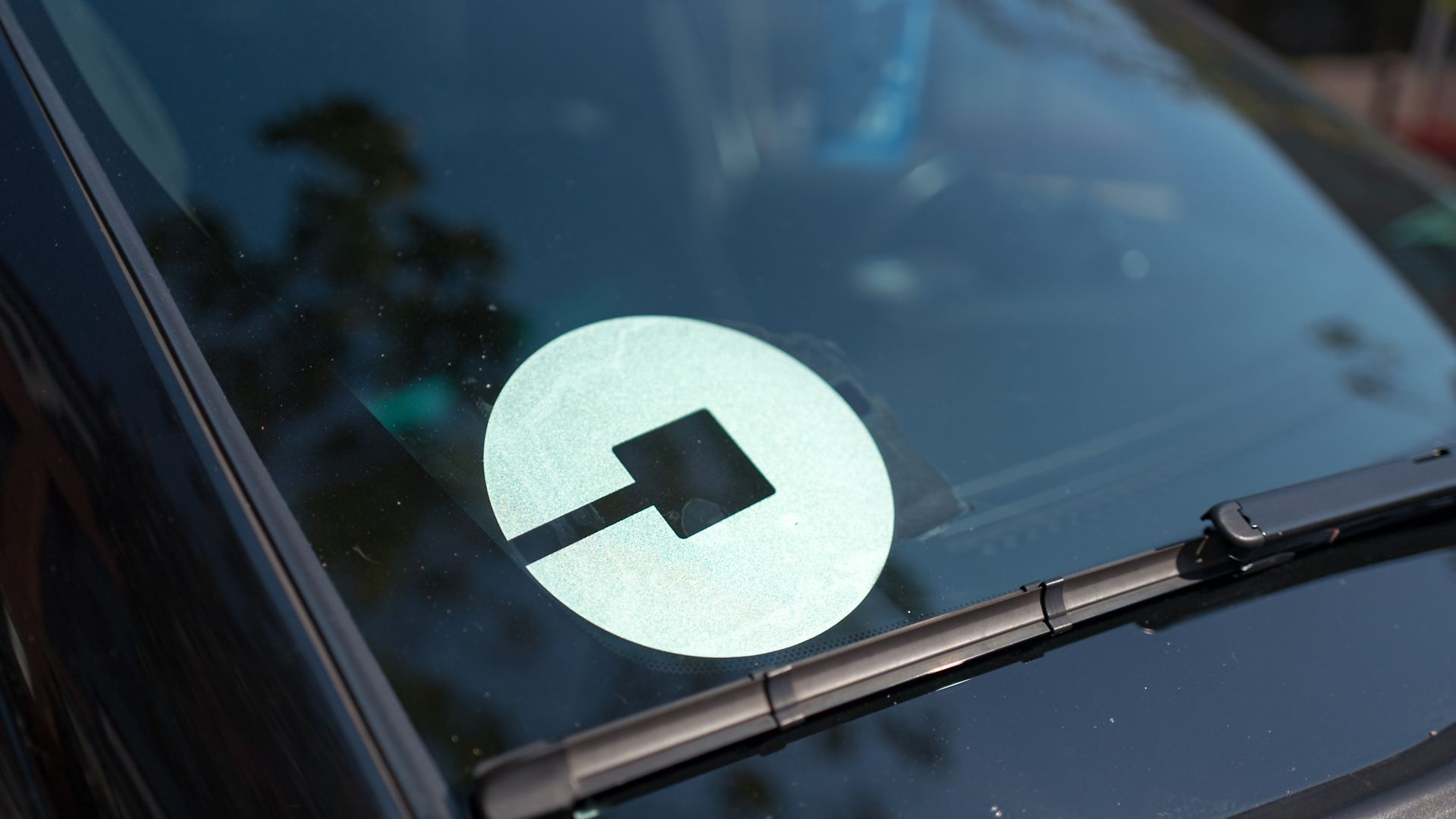 An Uber logo in a windshield