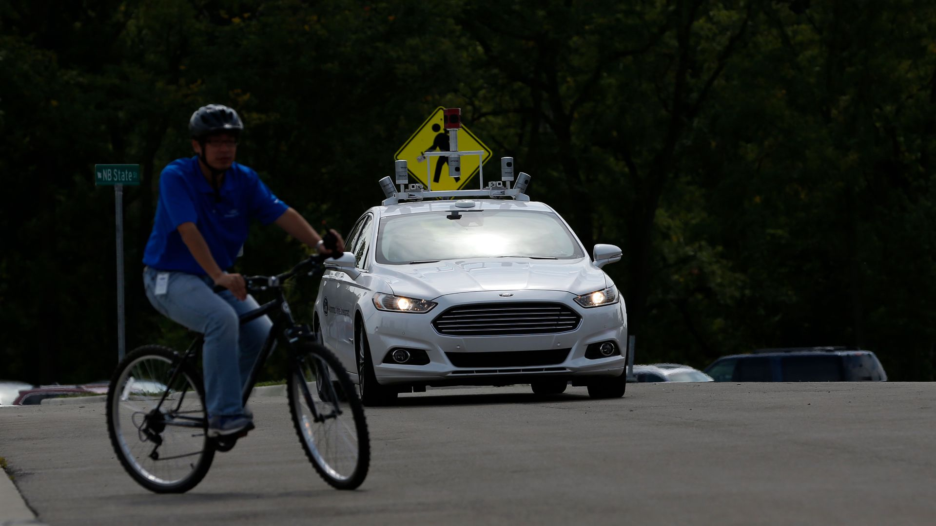 A Ford Fusion with Level 4 Autonomous controls maneuvers at the Mcity Test Facility in Ann Arbor, Michigan.