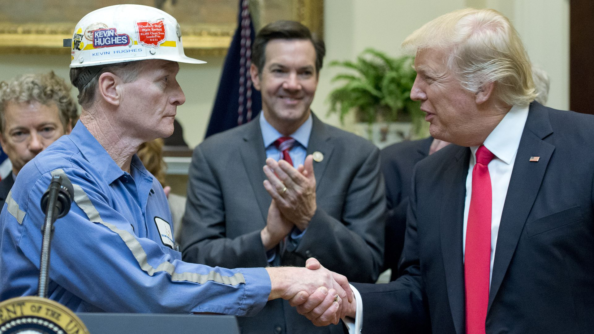 Trump shaking hands with a coal miner