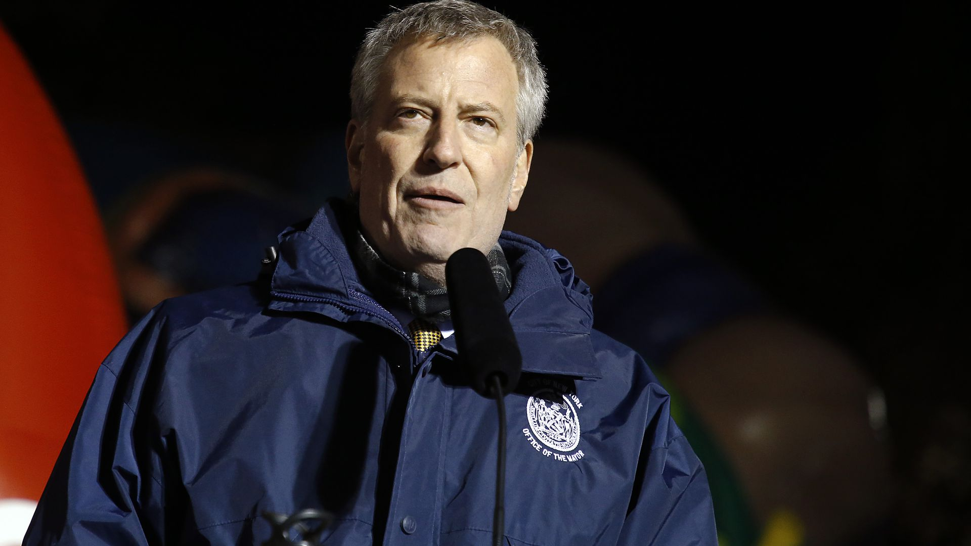 New York Mayor Bill de Blasio in a rain jacket