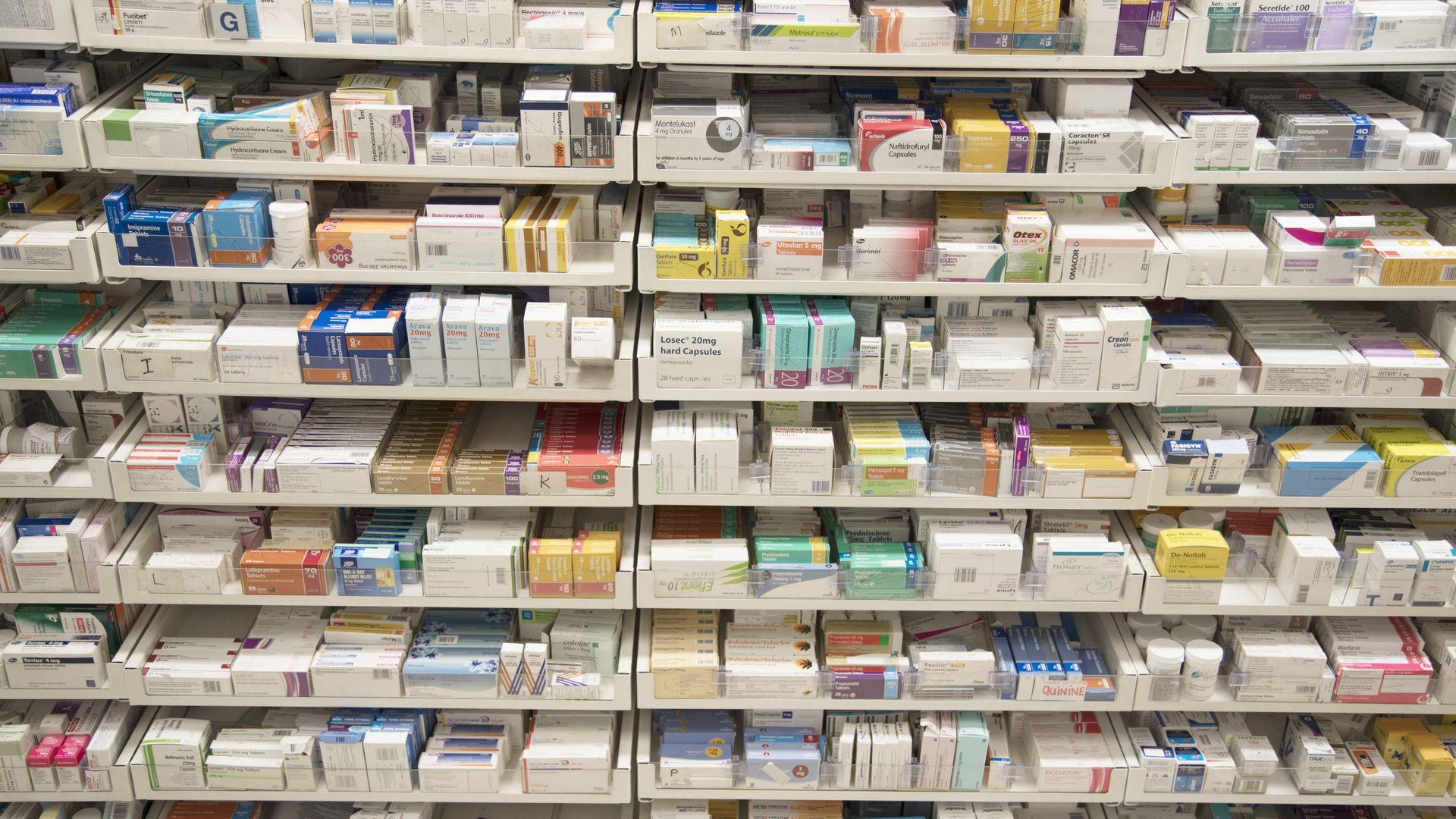 Shelves of prescription drugs at a pharmacy.