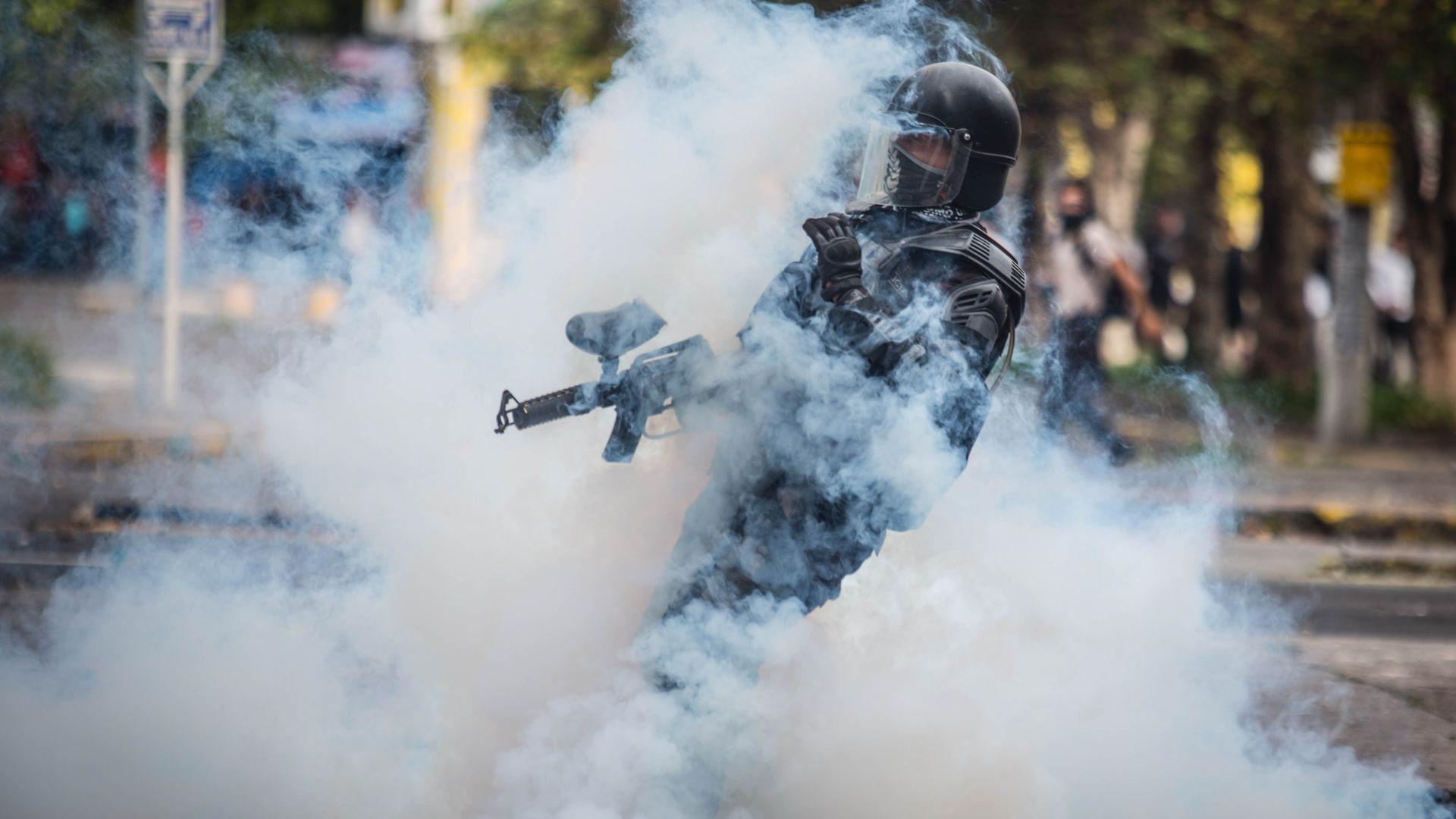 Riot police confront demonstrators during clashes in Quito.