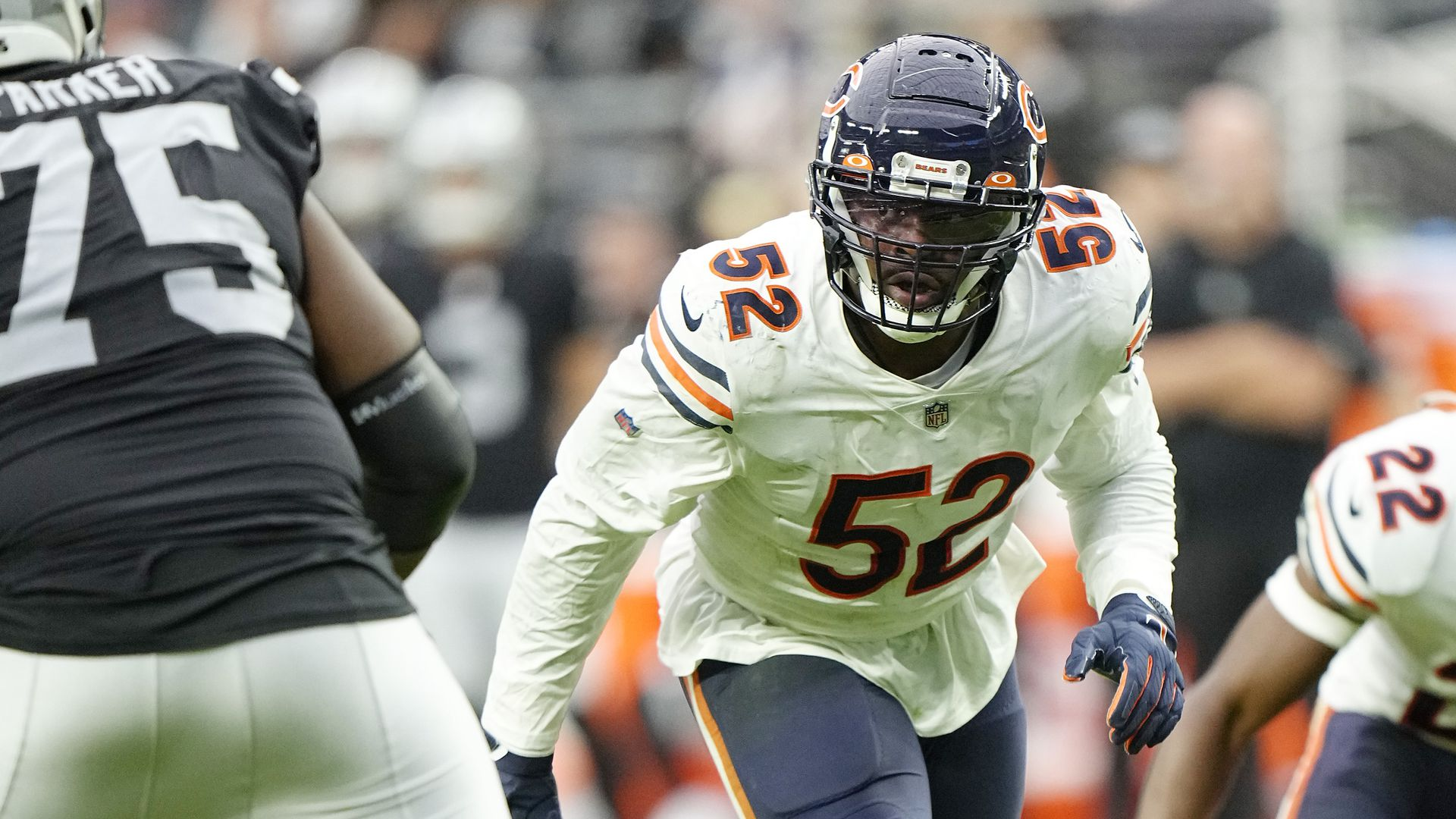 Khalil Mack lines up for a football play.