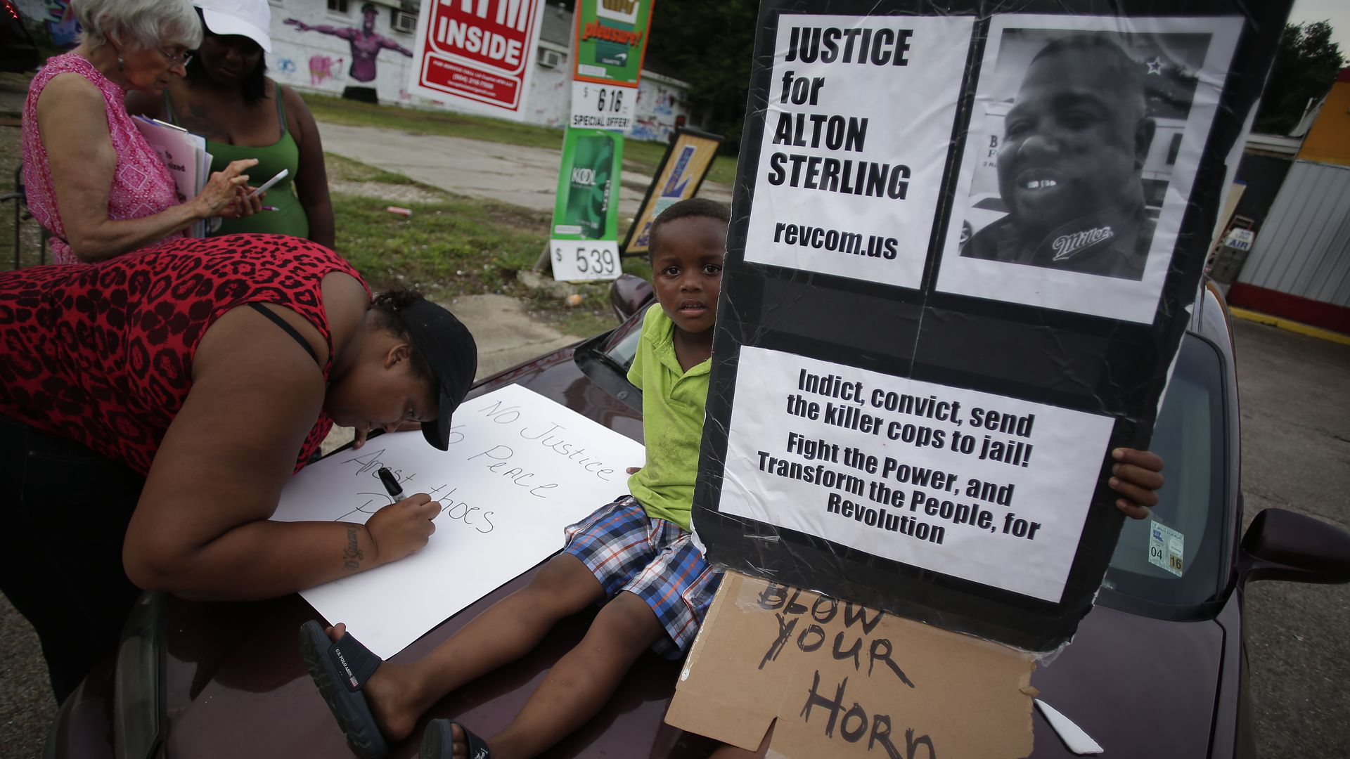 Demonstrators protest the fatal police shooting of Alton Sterling July 21, 2016.