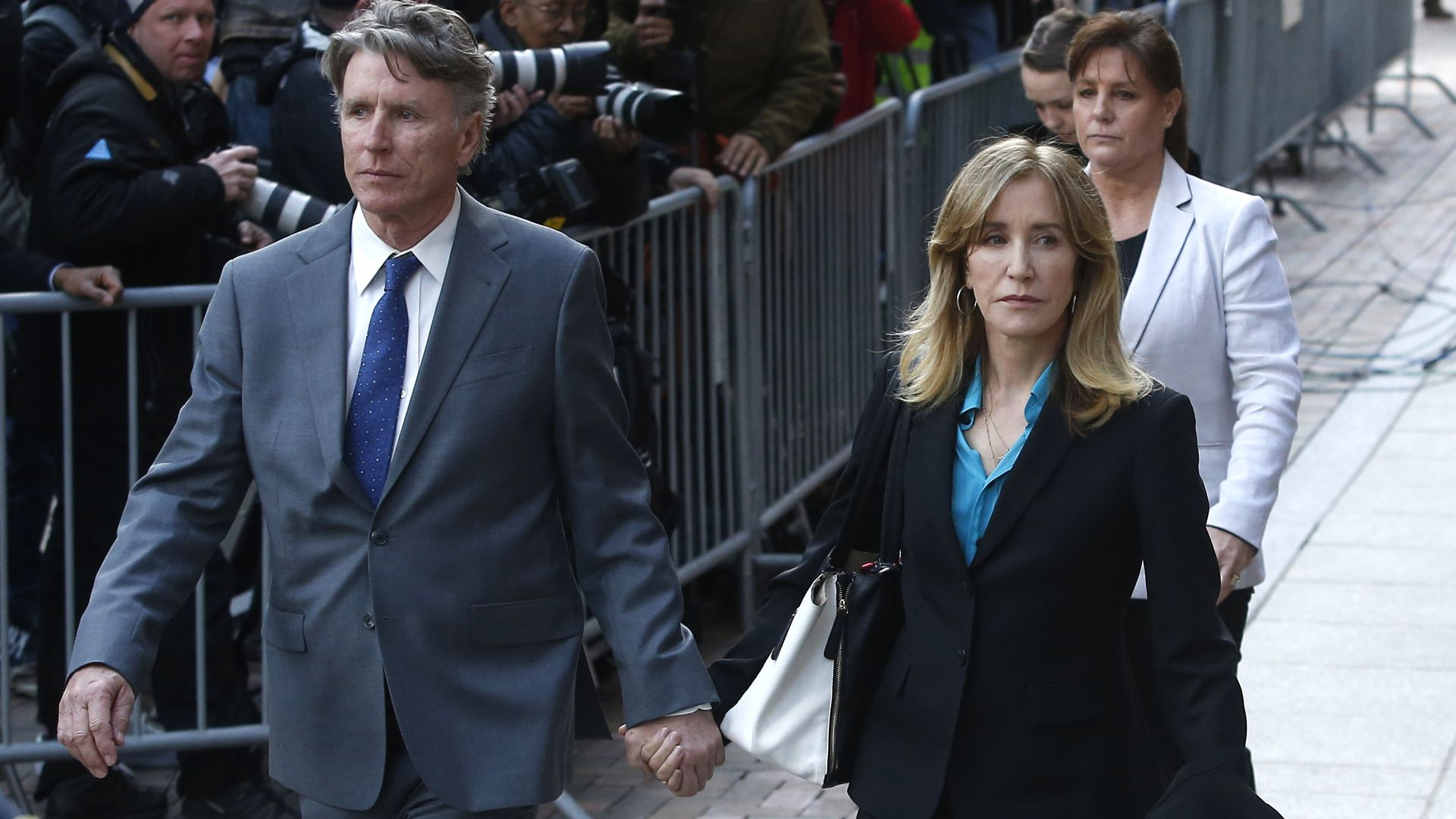 Actress Felicity Huffman with her husband outside Boston courthouse
