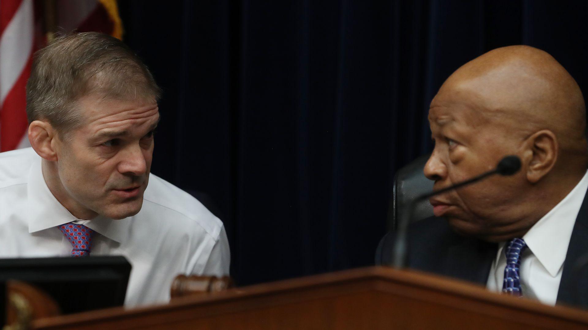 Rep. Elijah E. Cummings speaking with Rep. Jim Jordan at the House Oversight Committee