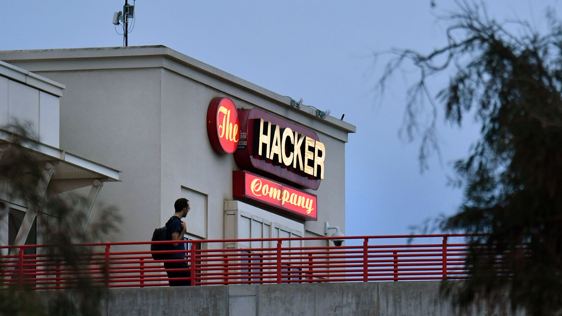 "A sign at Facebook HQ reads ""The Hacker Company"""
