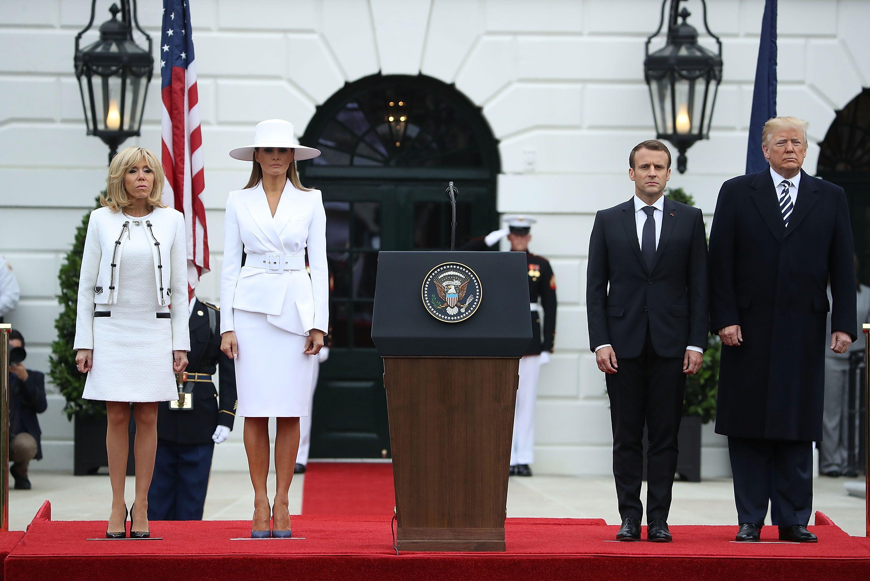 President Trump, Melania Trump, Emmanuel Macron and Brigette Macron standing side by side.