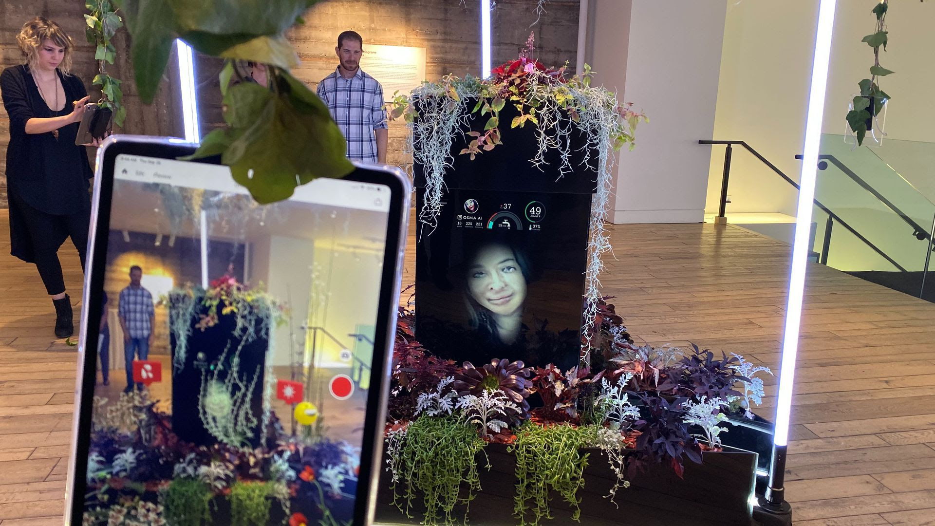 An image of Osma.ai, an augmented reality art project in which a terrarium is watered based on how many likes its AI-generated selfies get on Instagram