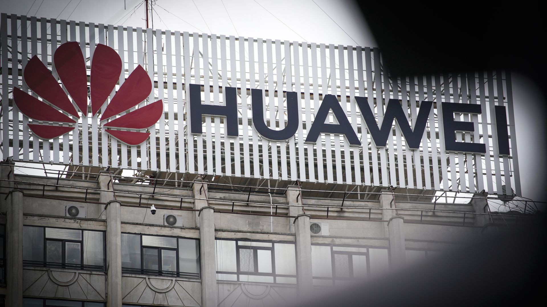 In this image, the Huawei sign and logo is displayed prominently on a building.