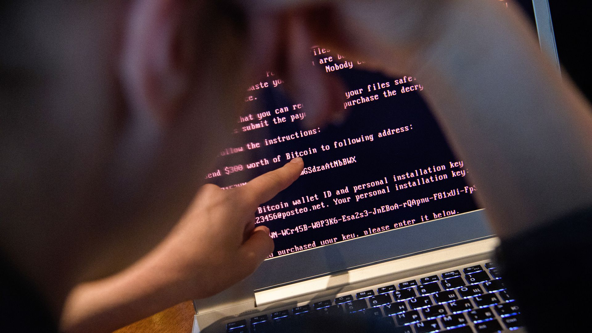 A computer user points at a system infected with the NotPetya malware