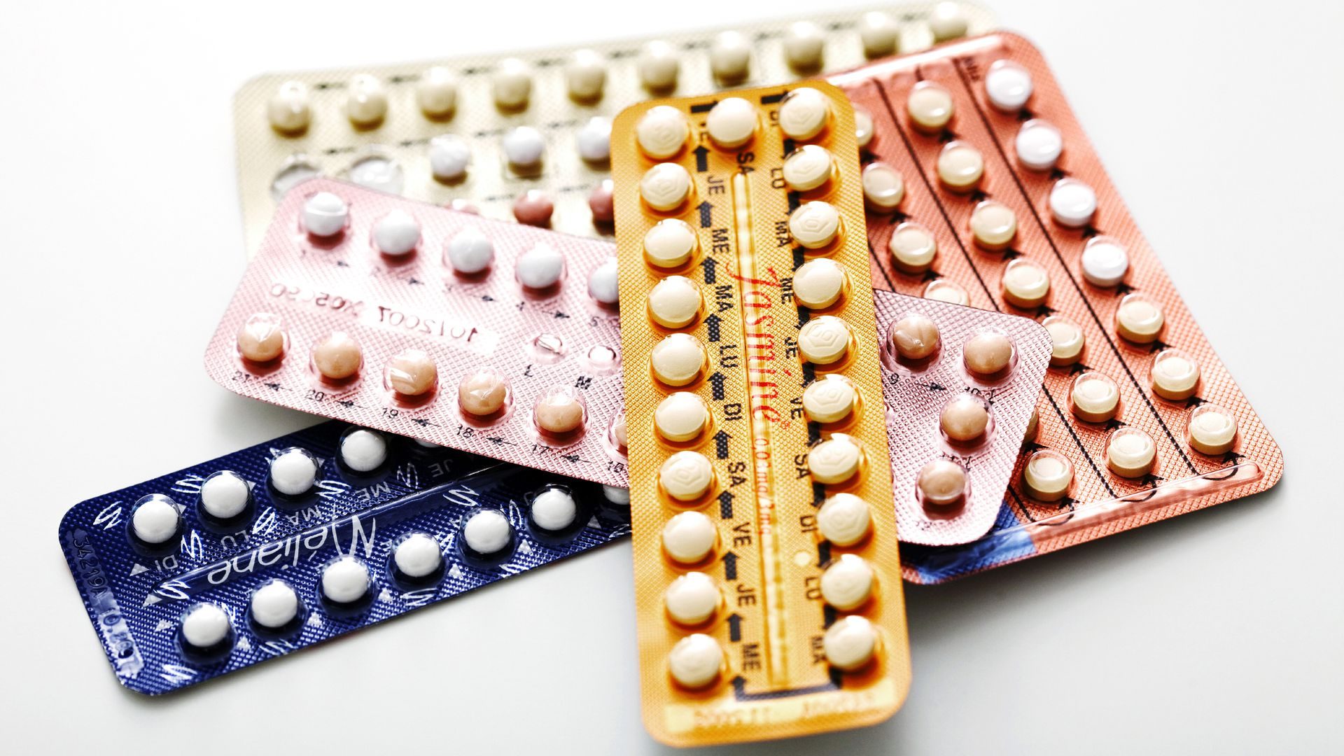 Birth control pills in multicolors in a stack.