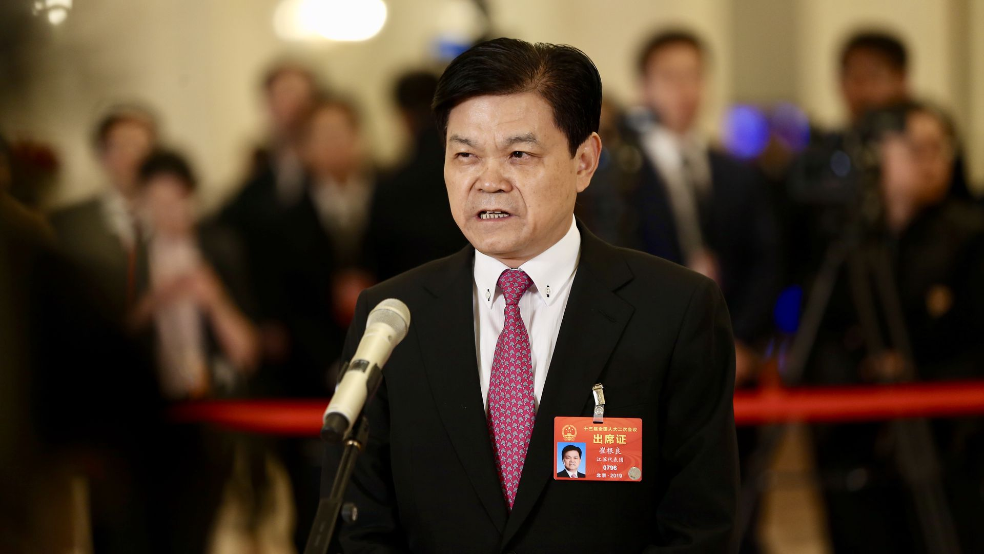 Hengtong Group Chairman Cui Genliang speaking at a microphone