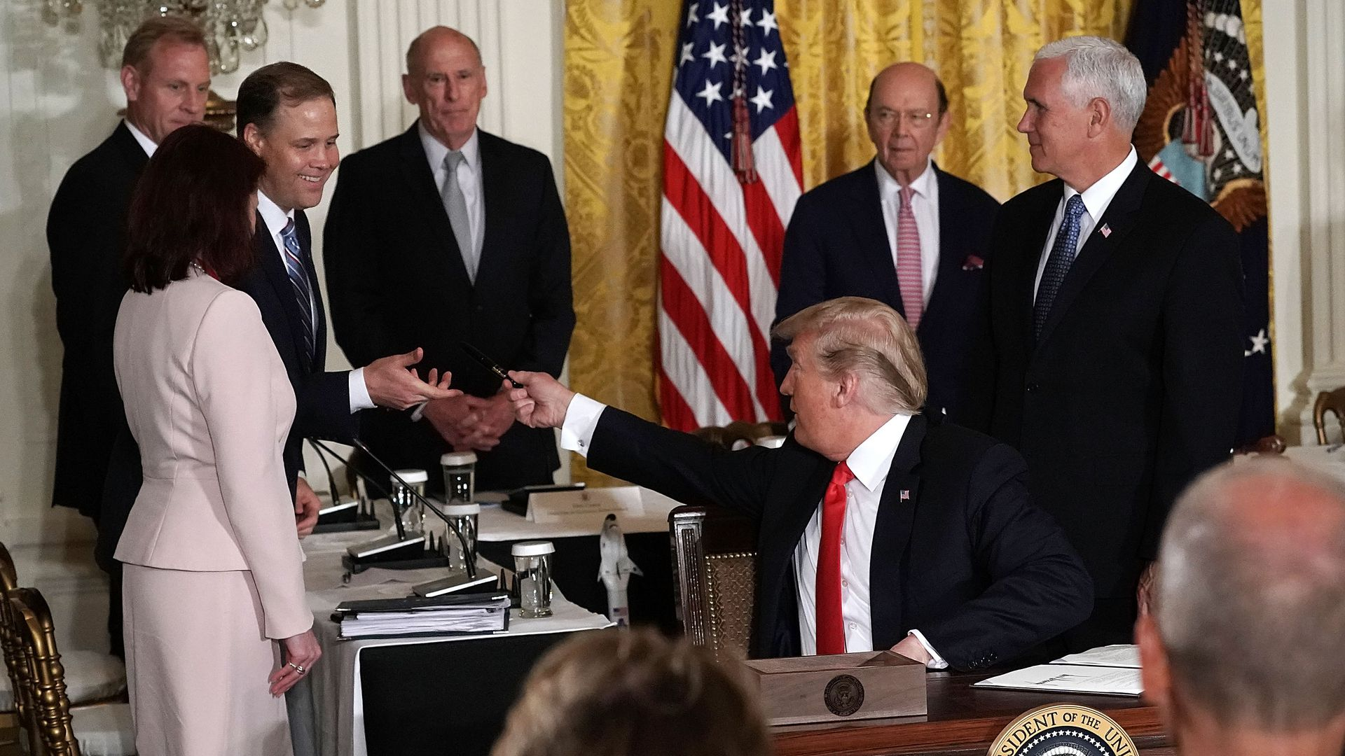 President Donald Trump shakes hands with NASA administrator Jim Bridenstine.