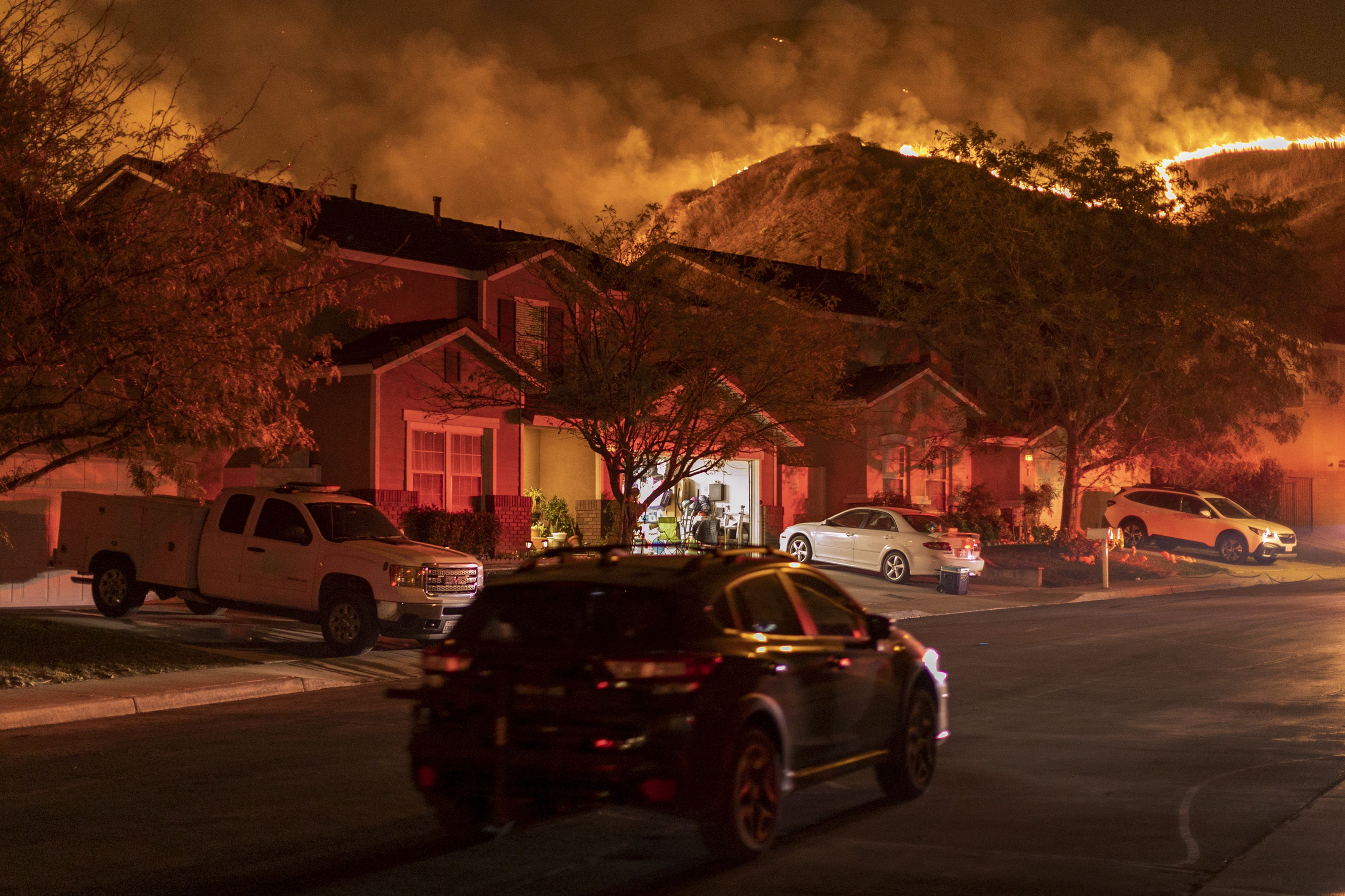 Flames come close to houses during the Blue Ridge Fire on October 27, 2020 in Chino Hills, California.