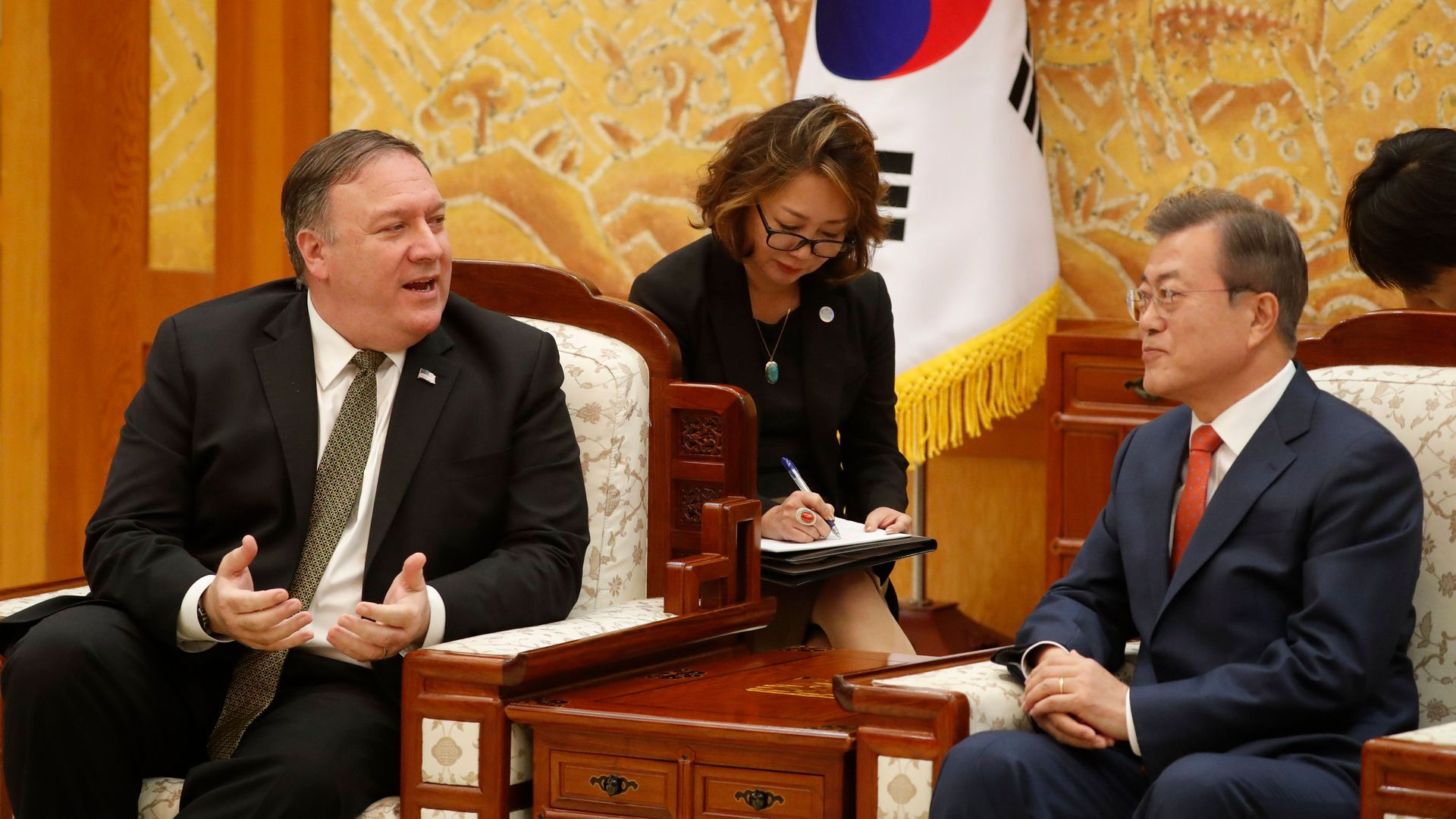 South Korean President Moon Jae-in (R) listens to US Secretary of State Mike Pompeo